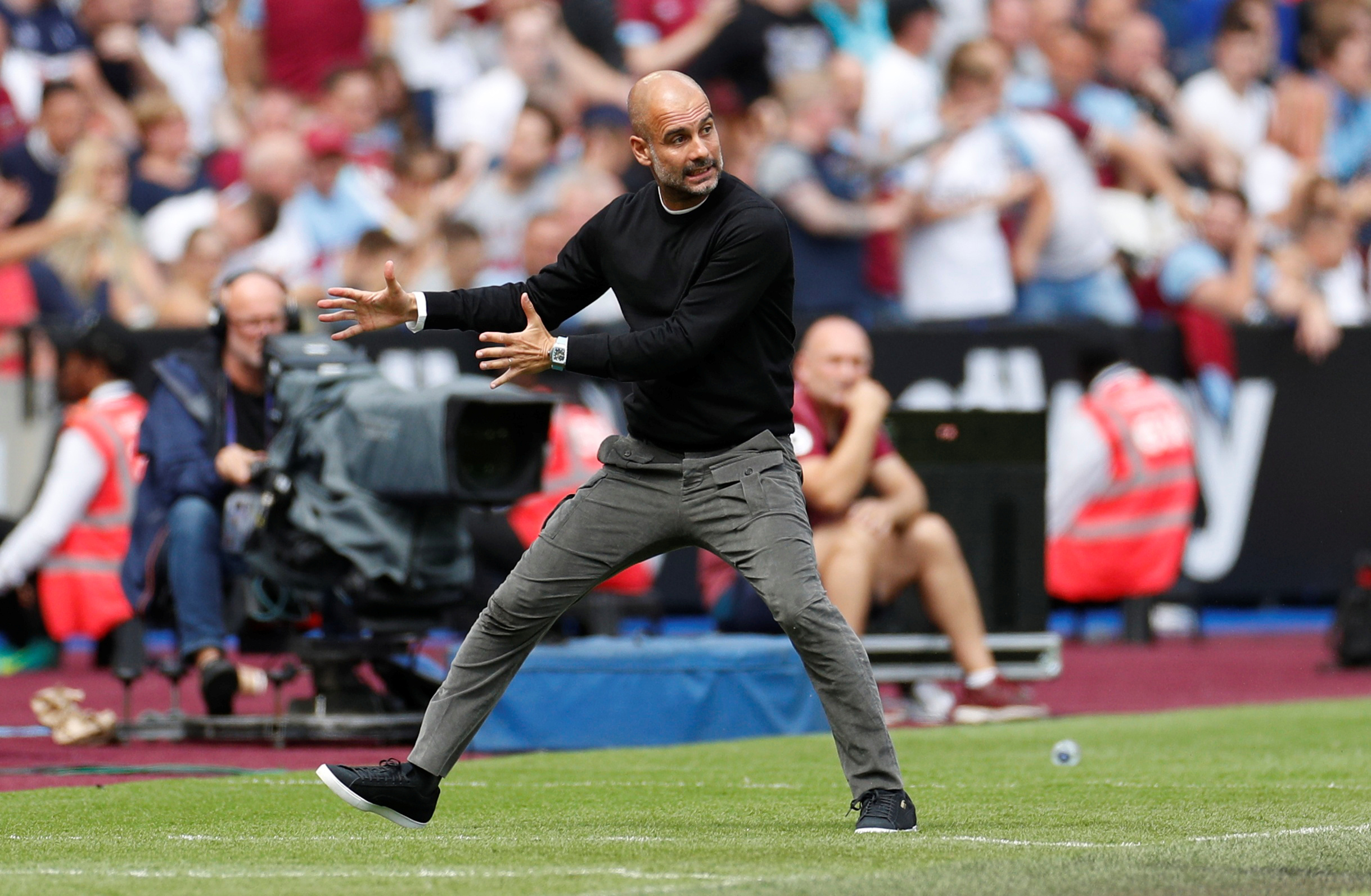 Soccer Football - Premier League - West Ham United v Manchester City - London Stadium, London, Britain - August 10, 2019  Manchester City manager Pep Guardiola gestures   Action Images via Reuters/John Sibley  EDITORIAL USE ONLY. No use with unauthorized audio, video, data, fixture lists, club/league logos or