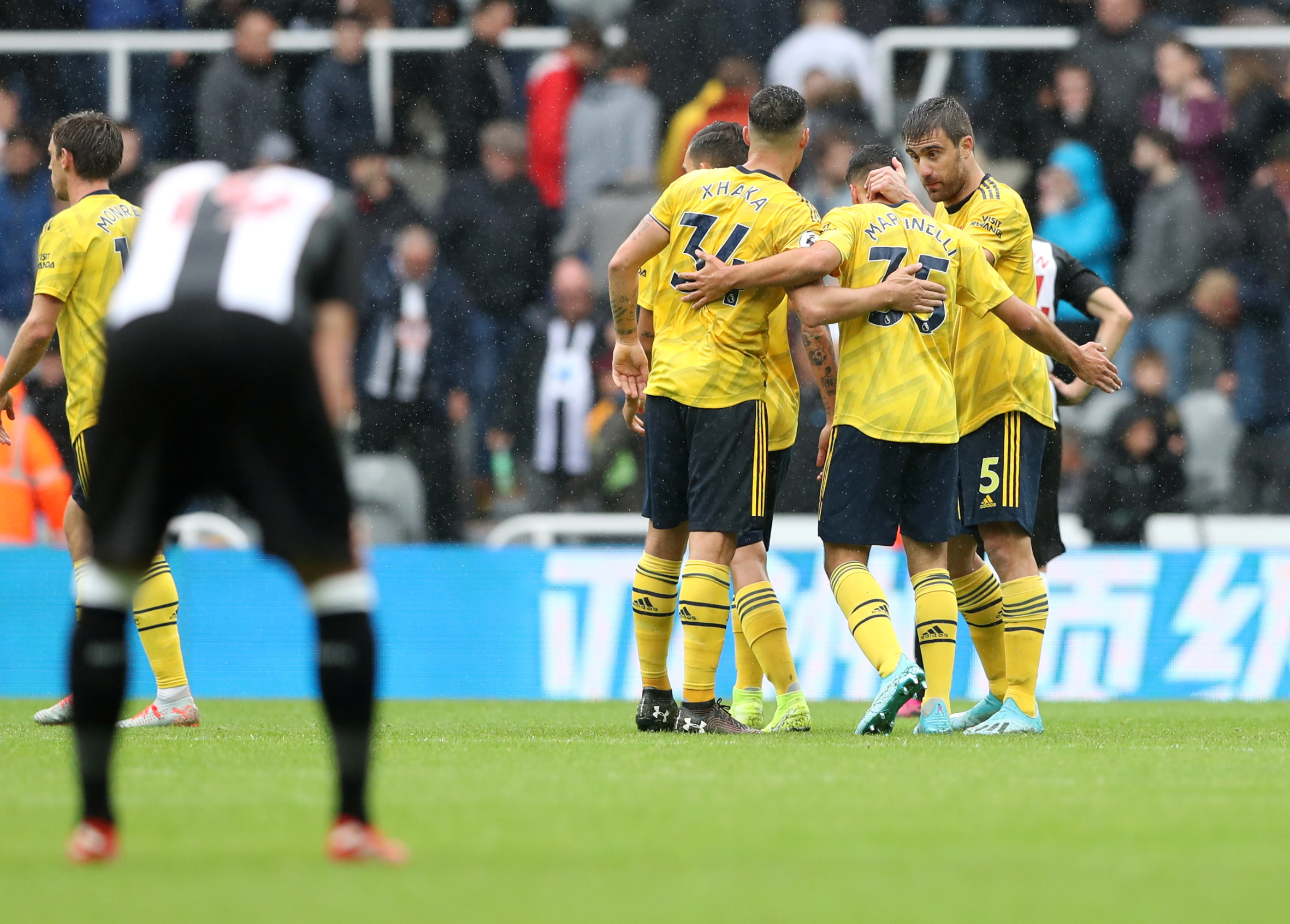 Soccer Football - Premier League - Newcastle United v Arsenal - St James' Park, Newcastle, Britain - August 11, 2019   Arsenal players celebrate after the match    REUTERS/Scott Heppell    EDITORIAL USE ONLY. No use with unauthorized audio, video, data, fixture lists, club/league logos or