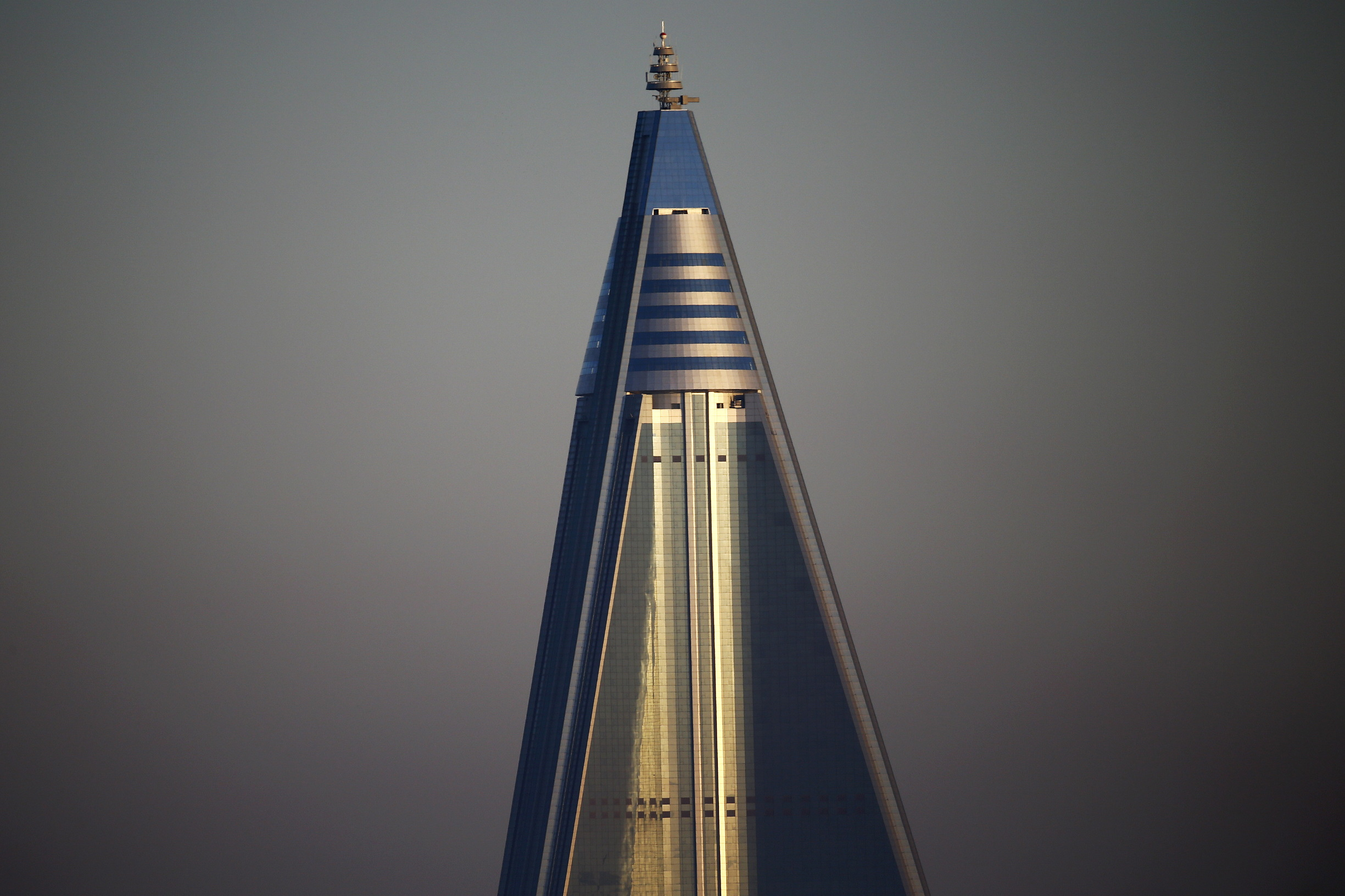 The top of the 105-storey Ryugyong Hotel, the highest building under construction in North Korea, is seen in Pyongyang, North Korea early October 9, 2015. North Korea is getting ready to celebrate the 70th anniversary of the founding of its ruling Workers' Party of Korea on October 10. REUTERS/Damir Sagolj - GF10000238167