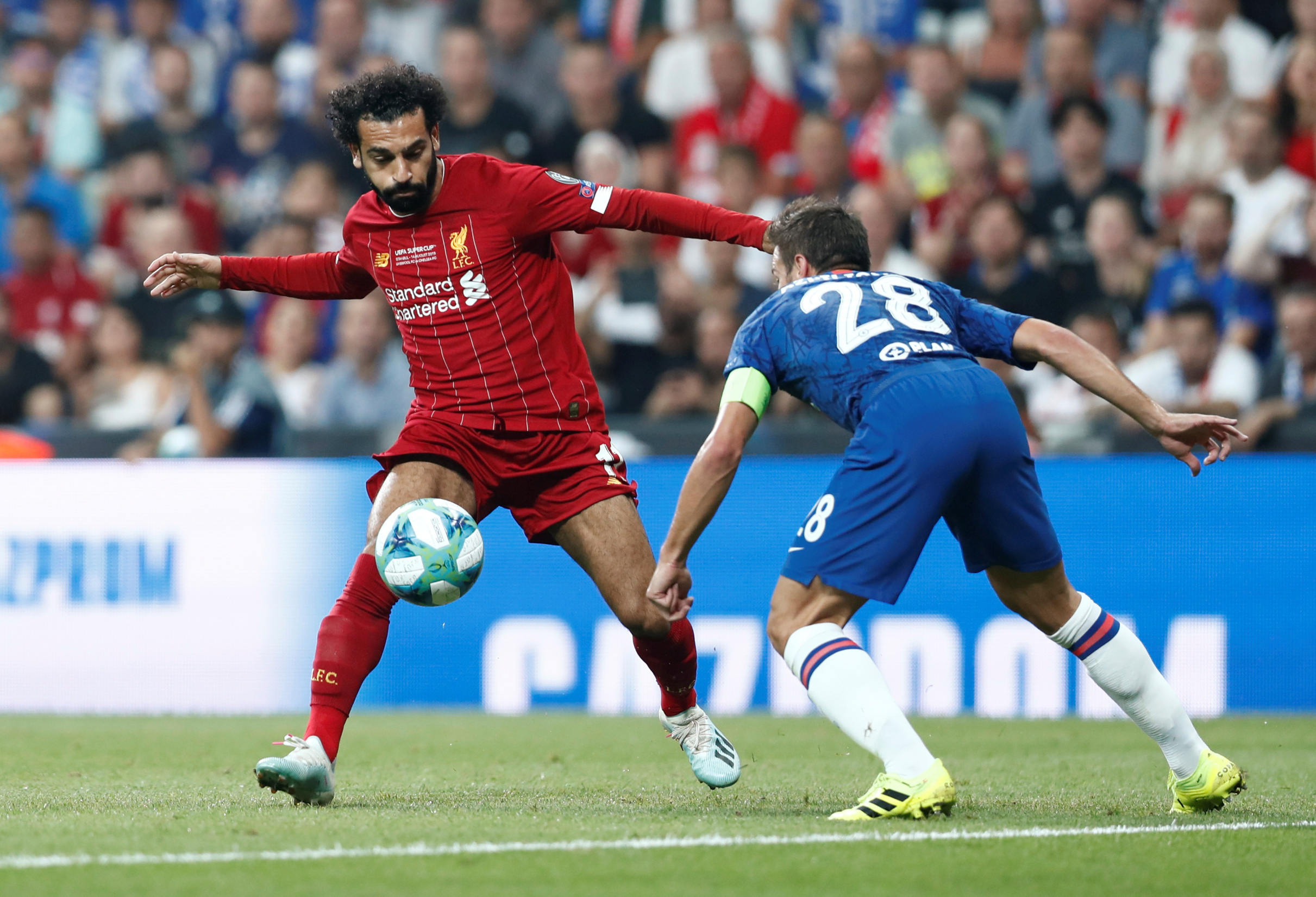 Soccer Football - UEFA Super Cup - Liverpool v Chelsea - Vodafone Arena, Istanbul, Turkey - August 14, 2019  Liverpool's Mohamed Salah in action with Chelsea's Cesar Azpilicueta   REUTERS/Murad Sezer - RC1851936190