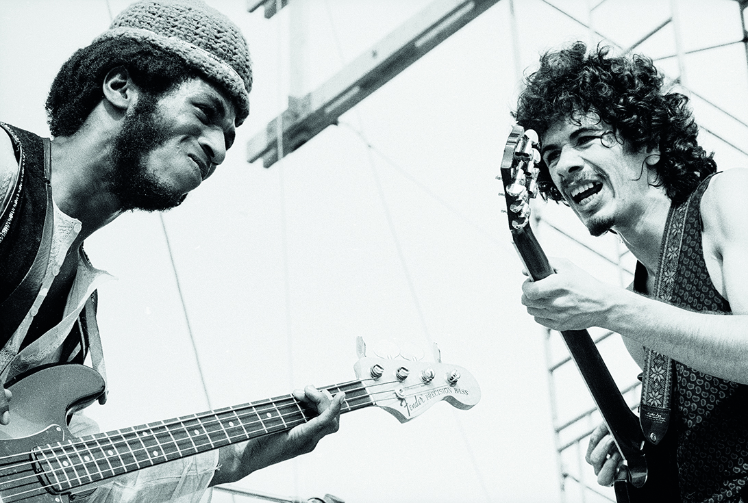 Mexican-born American musician Carlos Santana (right) and American bassist David Brown perform with the other members of Santana at 'Woodstock,' a large rock and roll music concert, Bethel, New York, August 16, 1969. (Photo by Tucker Ransom/Getty Images)