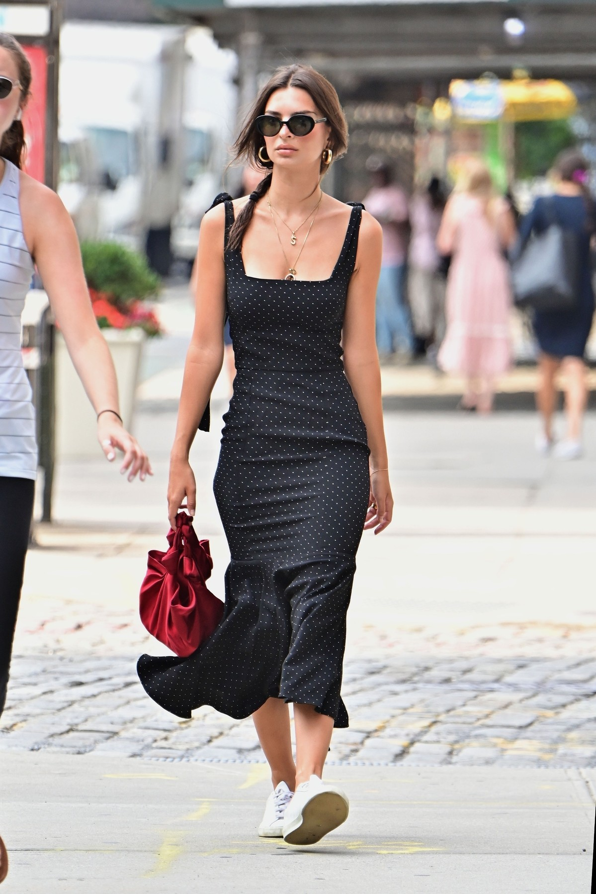 New York, NY  - Model, Emily Ratajkowski looks stylish in a black polka dot dress as she runs her early morning errands in New York. Emily is seen wearing a necklace with an 'S' pendant to represent her love for husband Sebastian Bear-McClard.  BACKGRID USA 19 AUGUST 2019, Image: 466117007, License: Rights-managed, Restrictions: RIGHTS: WORLDWIDE EXCEPT IN FRANCE, GERMANY, POLAND, Model Release: no, Credit line: Profimedia, Backgrid USA