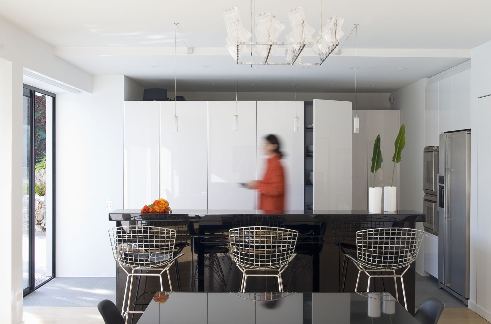 Woman in dining room of an architect-designed house