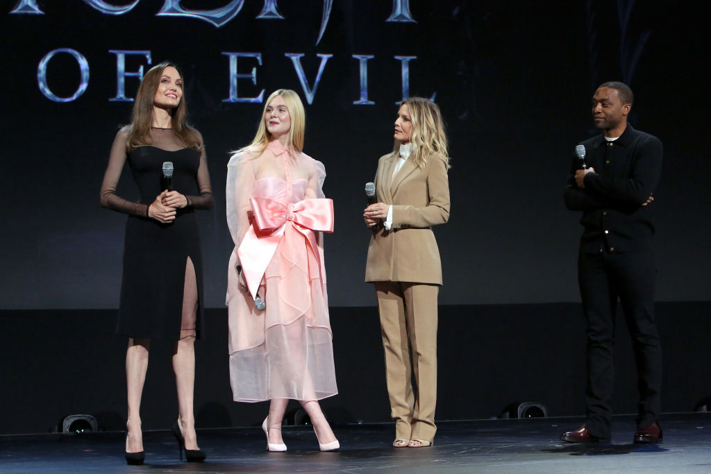ANAHEIM, CALIFORNIA - AUGUST 24: (L-R) Angelina Jolie, Elle Fanning, Michelle Pfeiffer, and Chiwetel Ejiofor of 'Maleficent: Mistress of Evil' took part today in the Walt Disney Studios presentation at Disney's D23 EXPO 2019 in Anaheim, Calif.  'Maleficent: Mistress of Evil' will be released in U.S. theaters on October 18, 2019. (Photo by Jesse Grant/Getty Images for Disney)