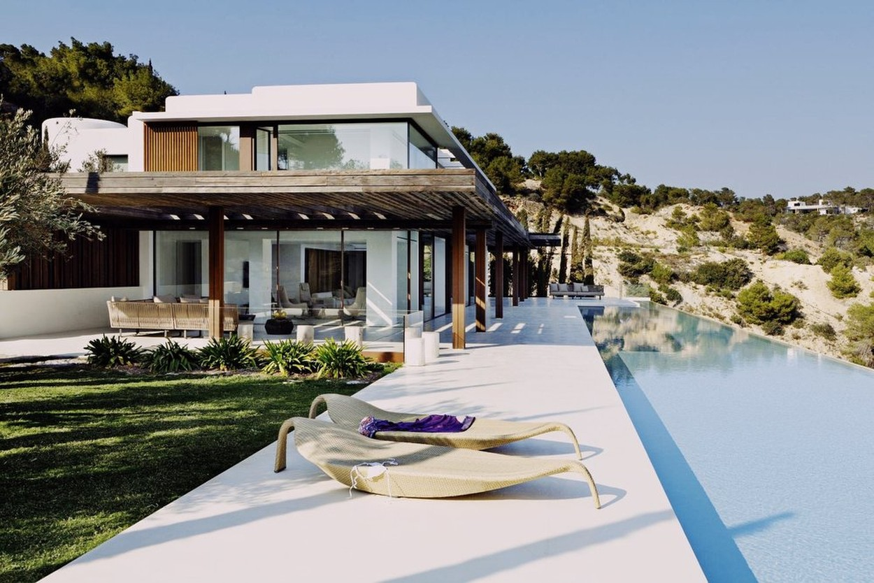 """Harry and Meghan stayed in a """"billionaires' playground"""" during their Ibiza break.  The couple, with baby Archie, went to the gated Vista Alegre complex, which boasts dozens of sea-facing luxury homes.   The totally secluded villas are on a hillside overlooking Porroig bay on the Spanish island's south-west coast. Insiders claim Harry and Meghan paid more than Ł25,000 to stay in one of the poshest homes.   Their holiday home included private beach access, an infinity pool, waterfront gym, Jacuzzi, a separate professional kitchen and live-in housekeepers.  The royals flew to Ibiza on a private jet before being whisked to the resort by car. Locals said the already-tight security presence was increased while they were in the complex., Image: 465999057, License: Rights-managed, Restrictions: , Model Release: no, Credit line: Profimedia, IMP Features"""