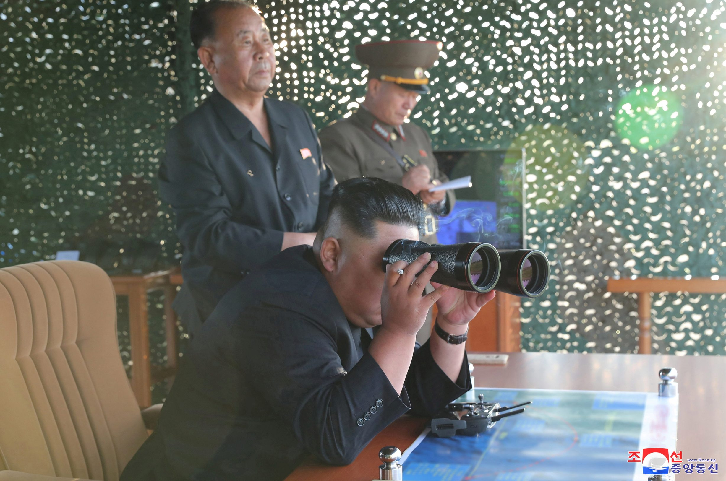 North Korean leader Kim Jong Un attends the test of a multiple rocket launcher in this undated photo released on August 25, 2019 by North Korea's Korean Central News Agency (KCNA). KCNA via REUTERS ATTENTION EDITORS - THIS IMAGE WAS PROVIDED BY A THIRD PARTY. REUTERS IS UNABLE TO INDEPENDENTLY VERIFY THIS IMAGE. NO THIRD PARTY SALES. SOUTH KOREA OUT. NO COMMERCIAL OR EDITORIAL SALES IN SOUTH KOREA.     TPX IMAGES OF THE DAY
