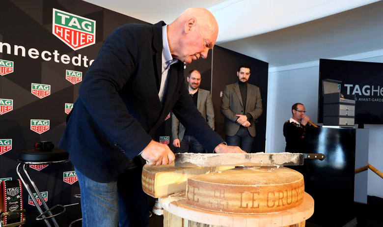 BRUNNEN, SWITZERLAND - MARCH 14:  Jean-Claude Biver, CEO of TAG Heuer and President of the LVMH Watch Division cut his own cheese after a press conference at the international launch of the TAG Heuer Connected Modular 45 Swiss Made on March 14, 2017 in Brunnen, Switzerland.  (Photo by Alexander Hassenstein/Getty Images For TAG Heuer)