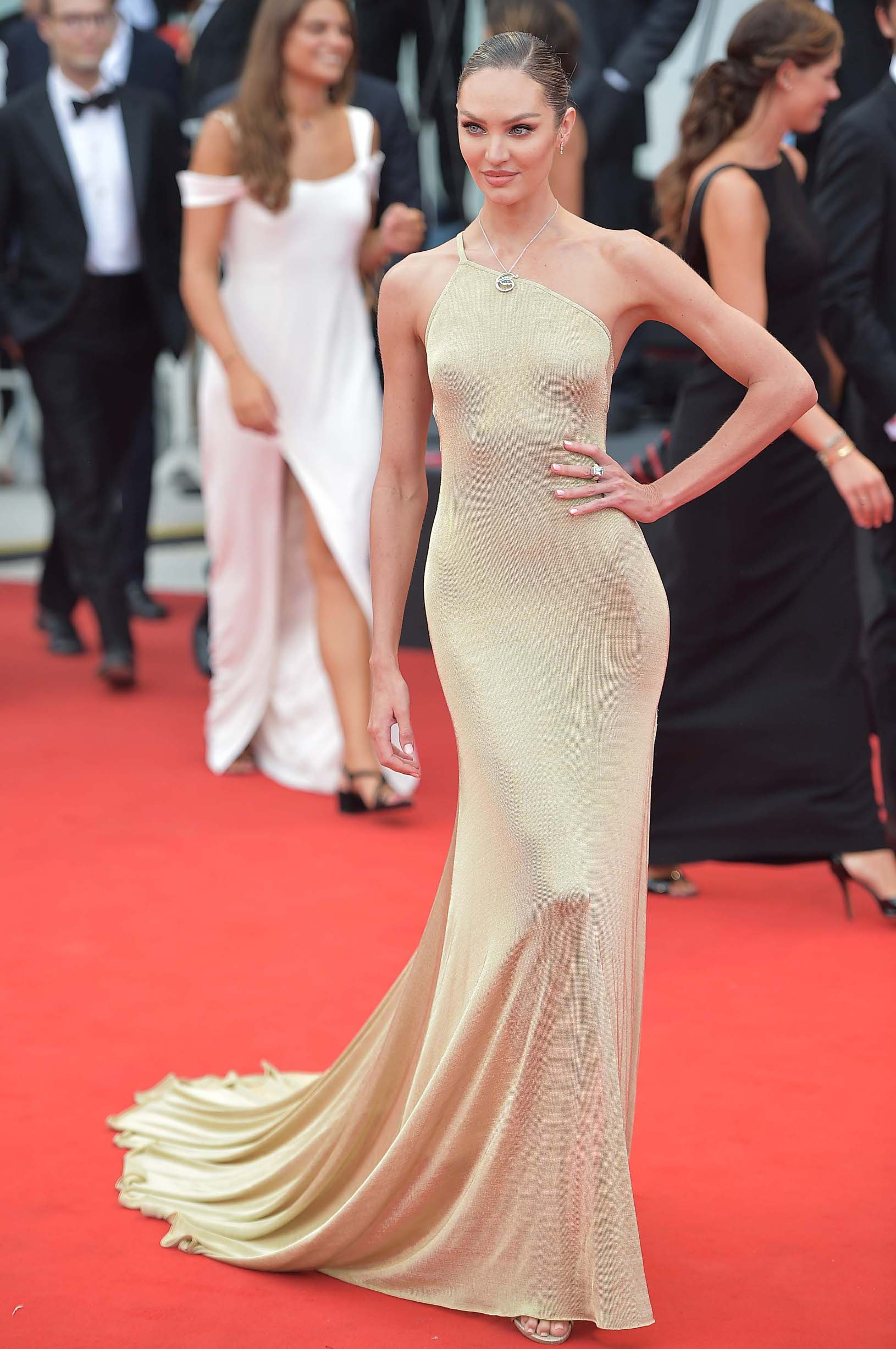 VENICE, ITALY - AUGUST 28:  Candice Swanepoel walks the red carpet ahead of the Opening Ceremony and the