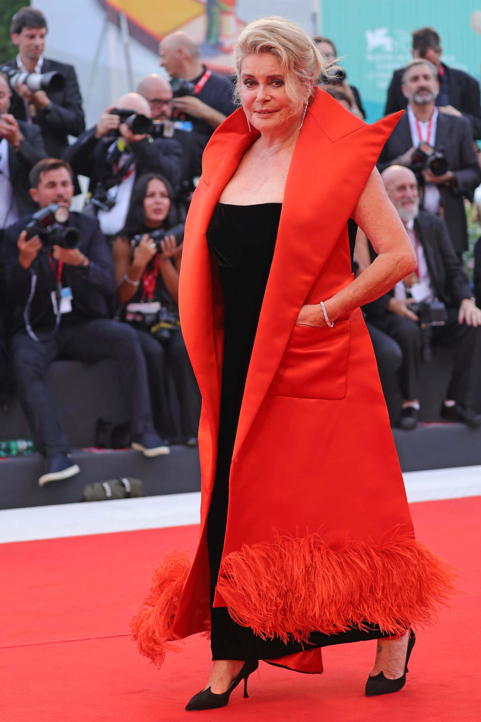 VENICE, ITALY - AUGUST 28:  Catherine Deneuve walks the red carpet ahead of the Opening Ceremony and the