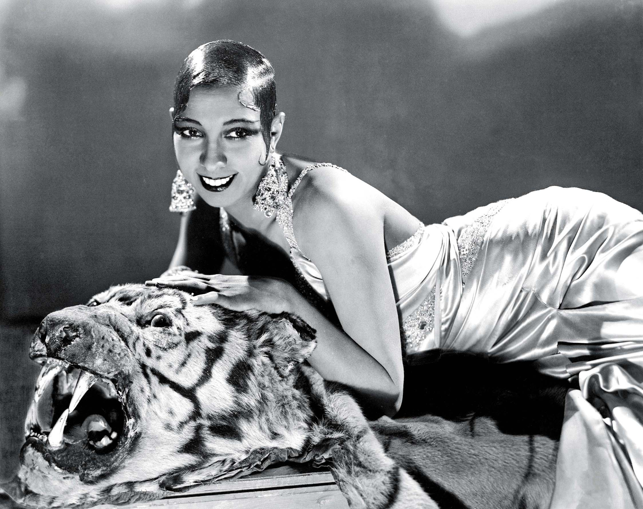 FRANCE - JANUARY 01:  Jospehine BAKER, as young, budding actress, lounging on a tiger skin, posing in a studio around the time of her first sensation La REVUE NEGRE.  (Photo by Keystone-France/Gamma-Keystone via Getty Images)