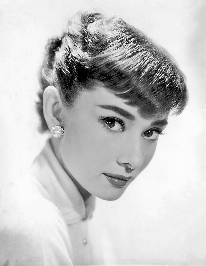 circa 1955:  Belgian-born actor Audrey Hepburn wearing earrings.  (Photo by Hulton Archive/Getty Images)