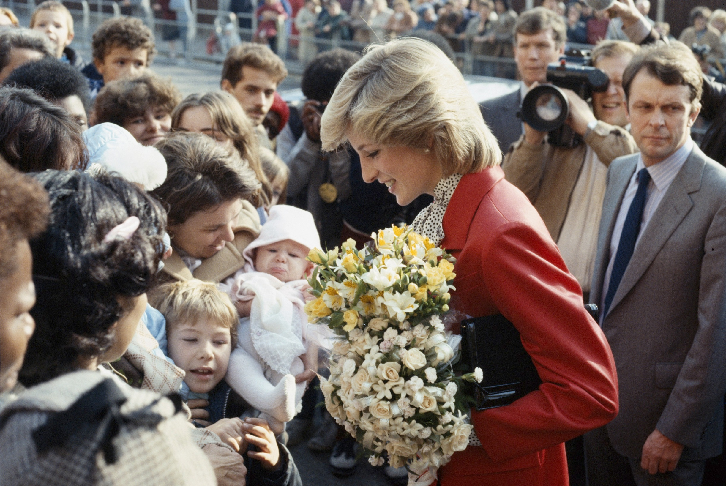 Princess Diana wearing a Jasper Conran suit during a visit to a community centre in Brixton, October 1983. (Photo by Princess Diana Archive/Getty Images)