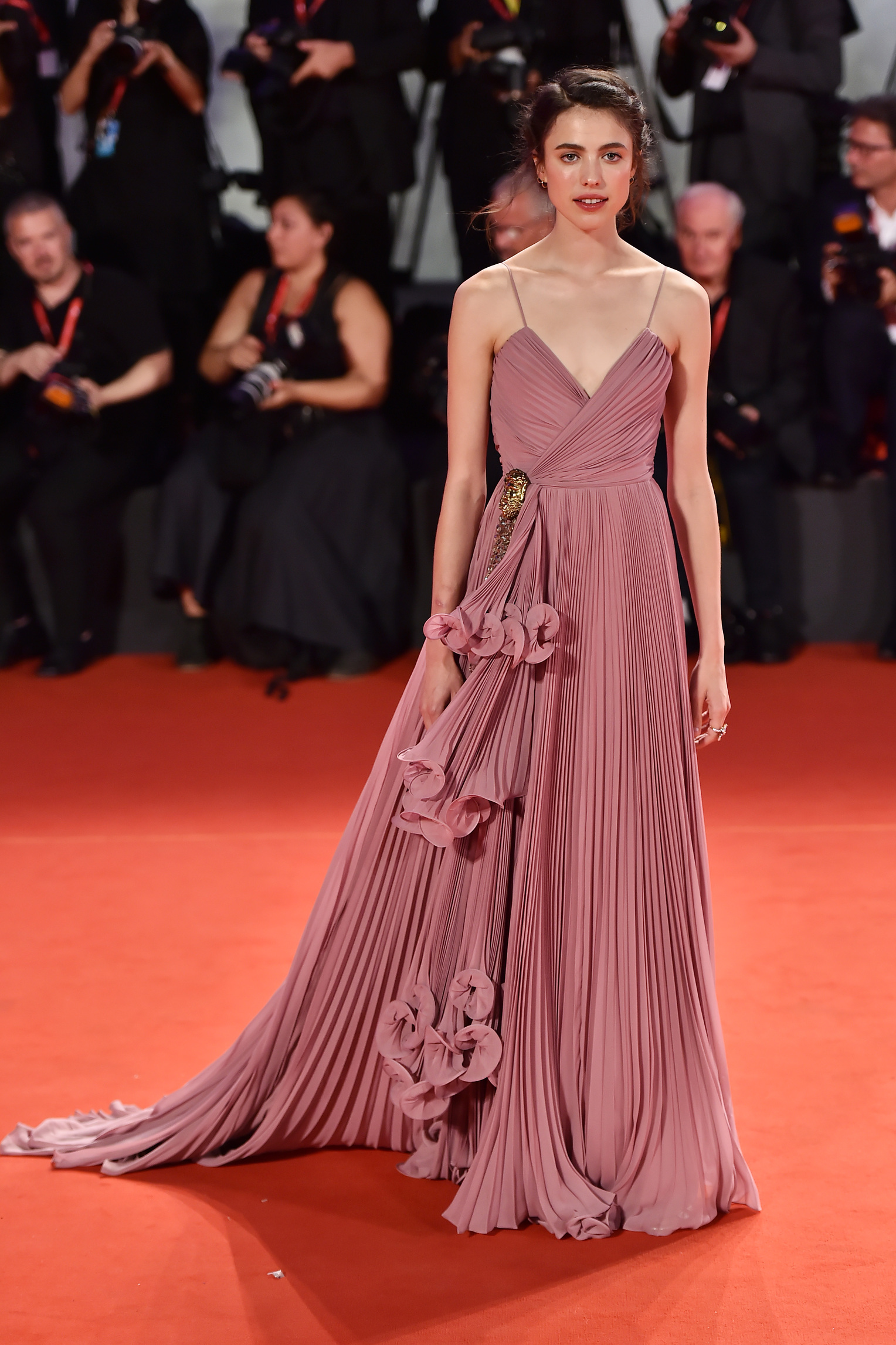 VENICE, ITALY - AUGUST 30: Margaret Qualley walks the red carpet ahead of the