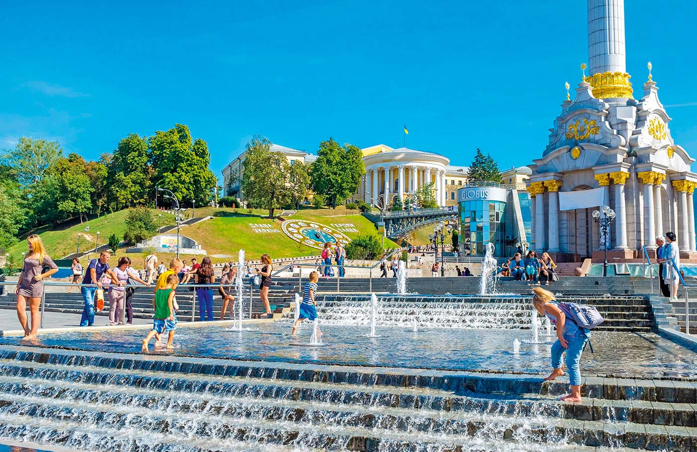 KIEV, UKRAINE - SEPTEMBER 8, 2016: The kids play in fountain in Maidan Nezalezhnosti (Independence Square) with the flower clock and October Palace on background, on September 8 in Kiev., Image: 318021681, License: Rights-managed, Restrictions: , Model Release: no, Credit line: Profimedia, Alamy