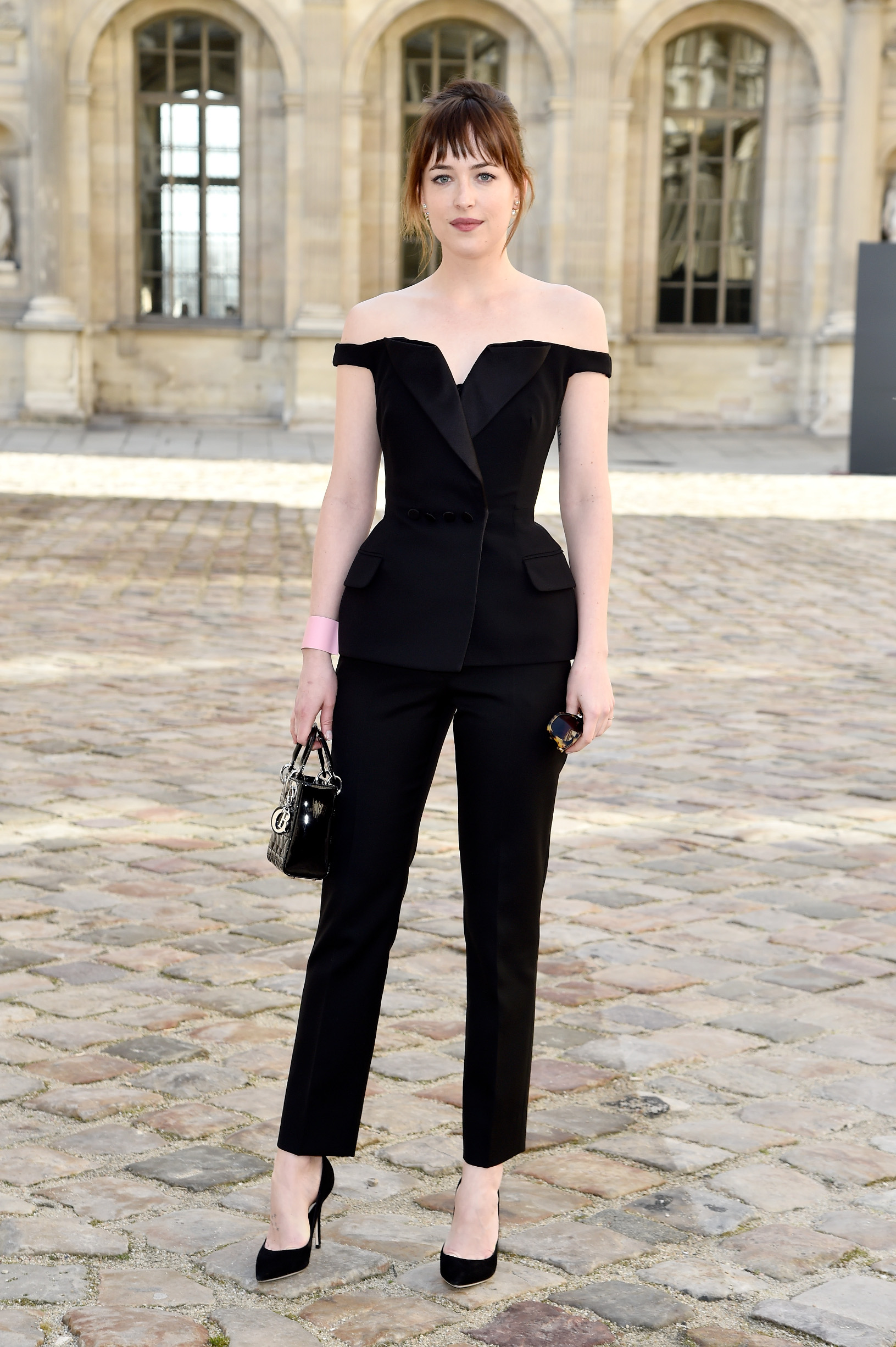 PARIS, FRANCE - MARCH 06:  Actress Dakota Johnson attends the Christian Dior show as part of the Paris Fashion Week Womenswear Fall/Winter 2015/2016 on March 6, 2015 in Paris, France.  (Photo by Pascal Le Segretain/Getty Images)