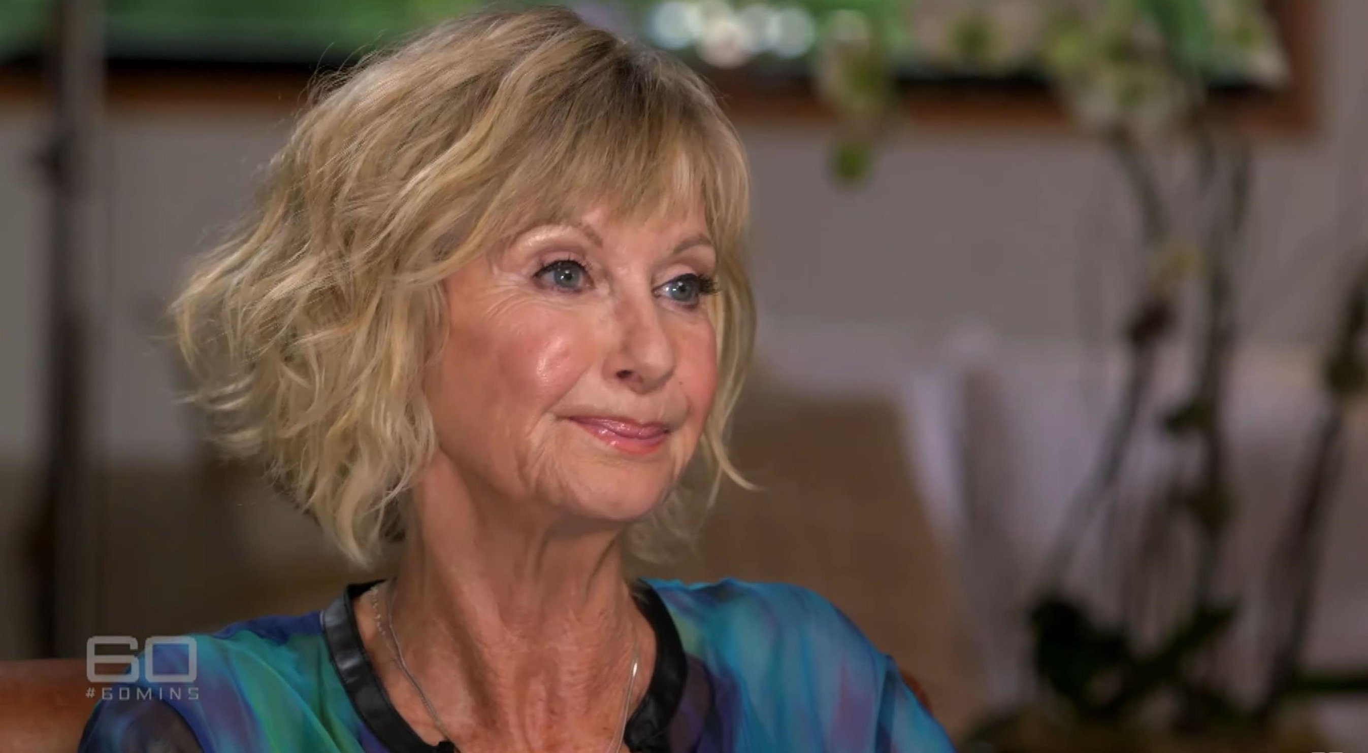 Los Angeles, CA  - Olivia Newton-John opens up about cancer diagnosis in candid 60 Minutes interview. The 70 year-old was diagnosed in 2017, after successfully beating the disease in 1992 and 2013. Speaking to reporter Liz Hayes, Olivia revealed how 'lucky' that she has been through it three times and was 'still here'.