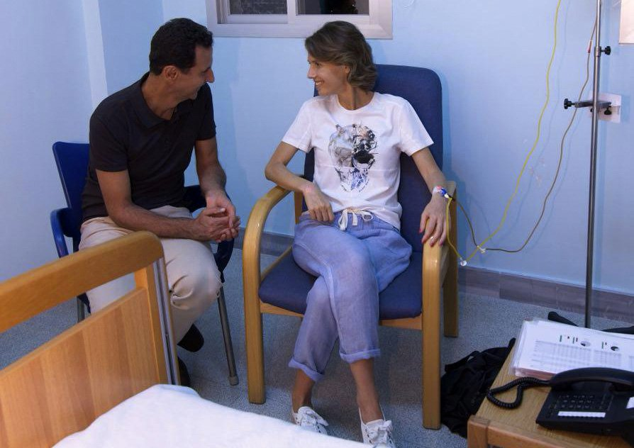 This handout picture released by the Syrian Presidency Facebook page on August 8, 2018, shows President Bashar al-Assad (L) sitting next to his wife Asma as she begins treatment for early-stage breast cancer at a hospital in the capital Damascus., Image: 381683067, License: Rights-managed, Restrictions: RESTRICTED TO EDITORIAL USE - MANDATORY CREDIT