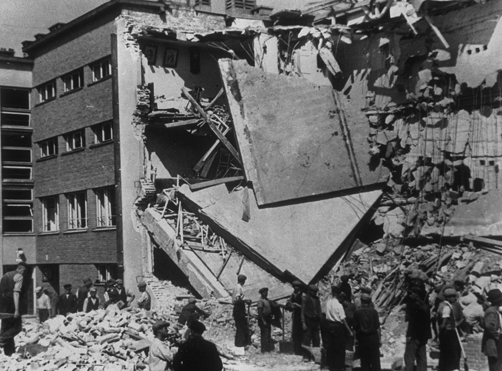 1939:  Air-raid bomb damage in Warsaw after the German invasion. Note the pictures still on the wall.  (Photo by Fox Photos/Getty Images)