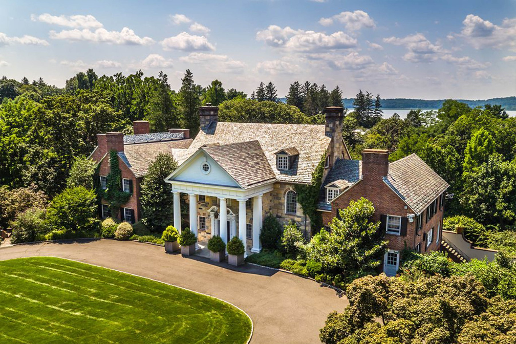 10-9-2019  Michael Douglas and Catherine Zeta-Jones have bought this house in Irvington, New York for .5 million. With 11,653 square feet of living space, there are 8 bedrooms, 10 full and 2 half bathrooms. Just 25 miles outside Manhattan and built in the early 1930s, the 22-room sits on 12 acres of land. Special features include an indoor swimming pool, fitness room, games lounge and seven fireplaces.  Pictured: Michael Douglas and Catherine Zeta-Jones's home, Image: 470108682, License: Rights-managed, Restrictions: , Model Release: no, Credit line: Profimedia, Planet