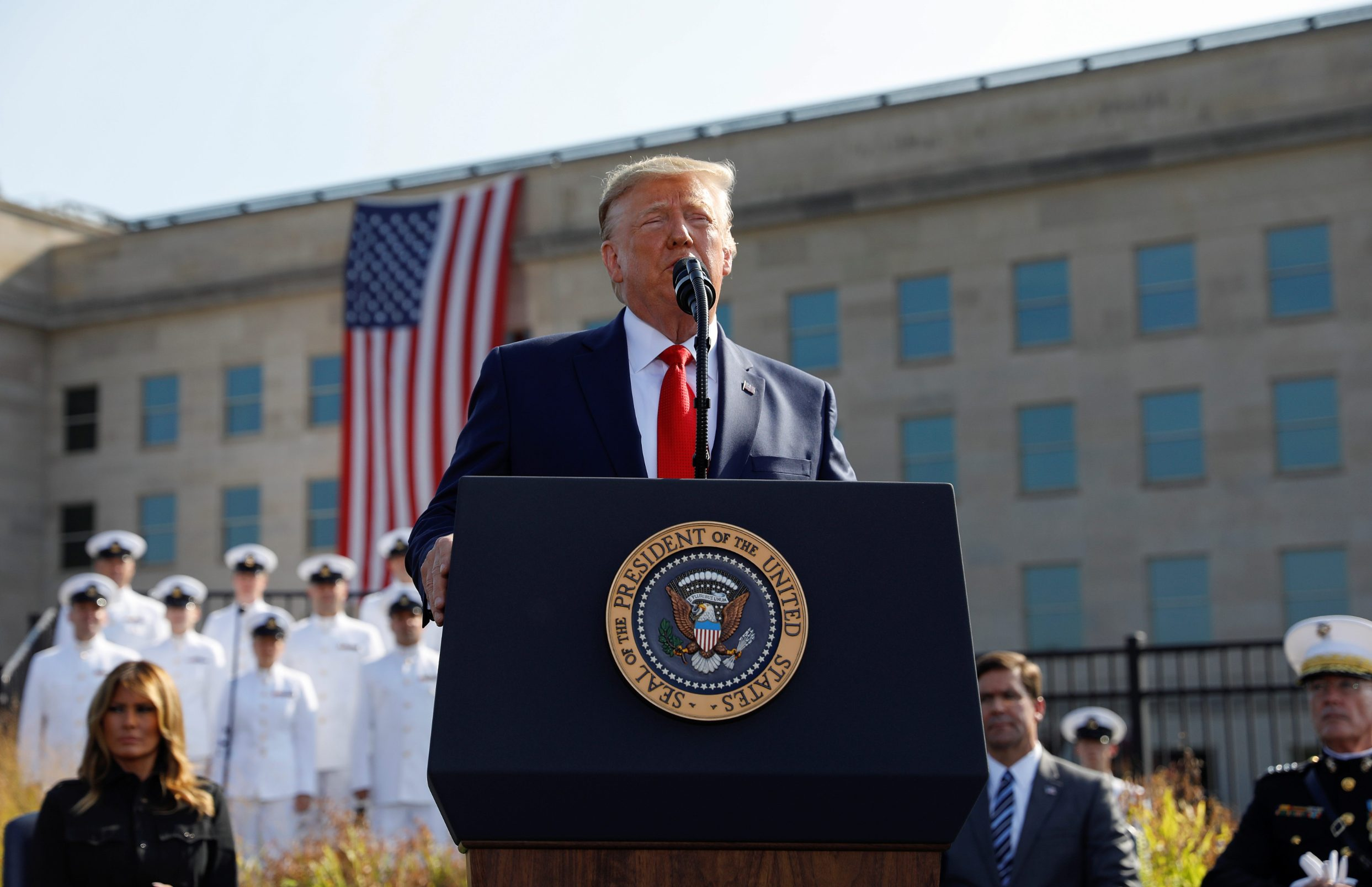 U.S. President Donald Trump speaks next to first lady Melania Trump and Defense Secretary Mark Esper during a ceremony marking the 18th anniversary of September 11 attacks at the Pentagon in Arlington, Virginia, U.S., September 11, 2019. REUTERS/Kevin Lamarque