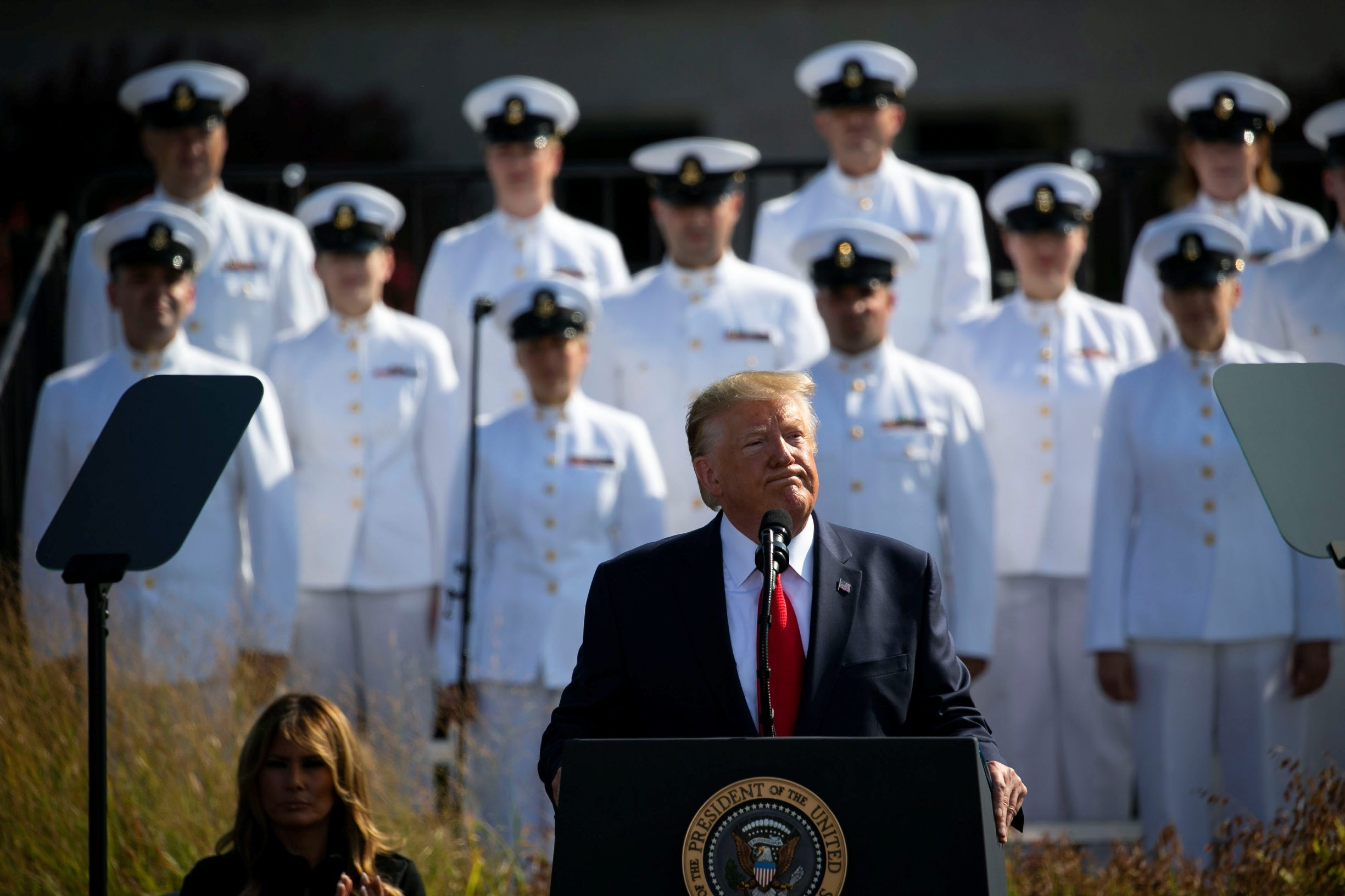 U.S. President Donald Trump speaks next to first lady Melania Trump during a ceremony marking the 18th anniversary of September 11 attacks at the Pentagon in Arlington, Virginia, U.S., September 11, 2019. REUTERS/Al Drago