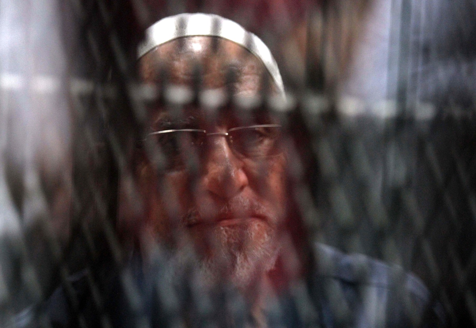 Egyptian Muslim Brotherhood Supreme Guide Mohamed Badie is seen behind bars during a verdict and sentencing session of a retrial for him and other Brotherhood members on charges of espionage with the Palestinian Hamas group at the Tora courthouse complex in southeastern Cairo on September 11, 2019. An Egyptian court on September 11 sentenced senior Muslim Brotherhood figures to life, a judicial source said. The defendants included the Brotherhood leader Mohamed Badie and his deputy Khairat al-Shater who were both handed life sentences -- 25 years. The court handed down five other defendants between seven to 10 year prison sentences. Only six were acquitted., Image: 470311677, License: Rights-managed, Restrictions: , Model Release: no, Credit line: Profimedia, AFP