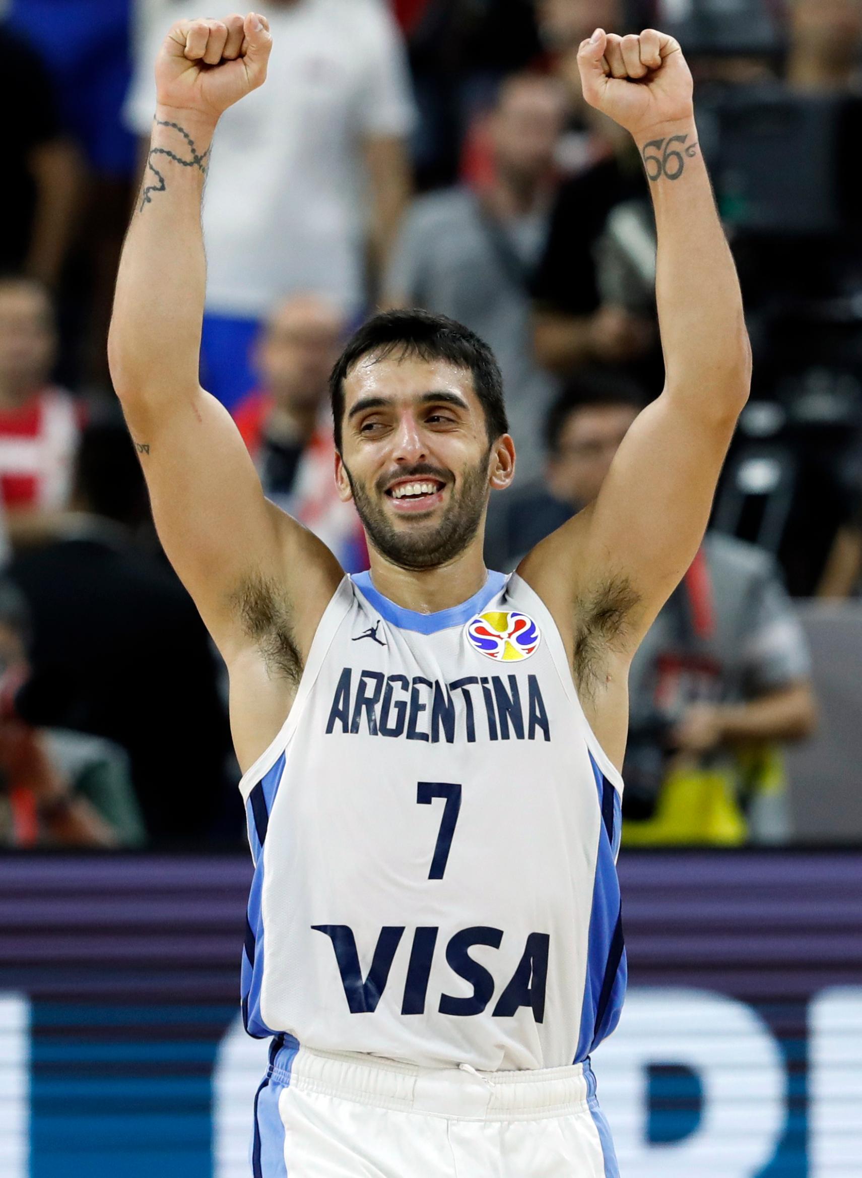 Basketball - FIBA World Cup - Quarter Finals - Argentina v Serbia - Dongguan Basketball Center, Dongguan, China - September 10, 2019  Argentina's Facundo Campazzo celebrates victory after the match REUTERS/Kim Kyung-Hoon