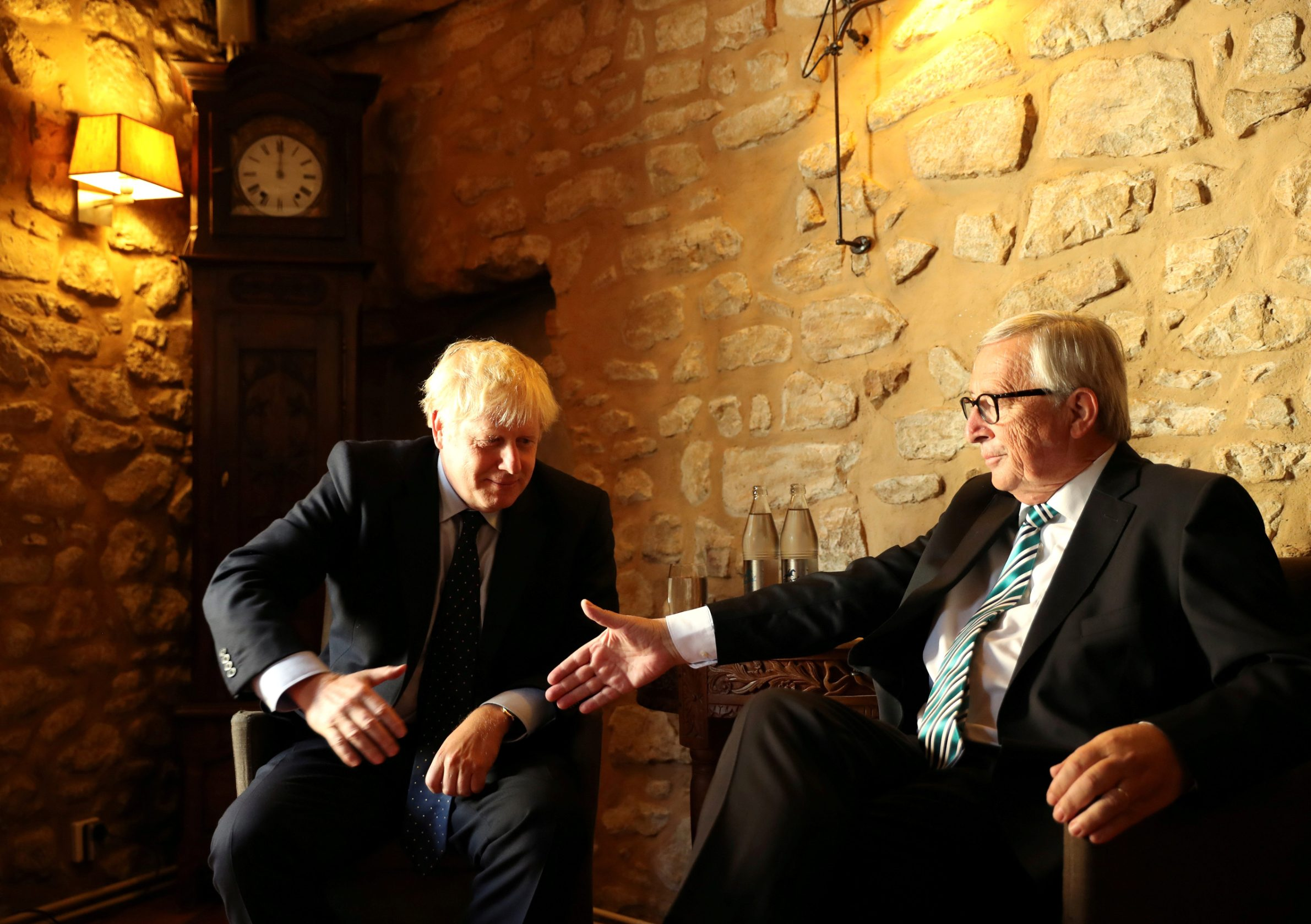 European Commission President Jean-Claude Juncker reaches out to shake hands with British Prime Minister Boris Johnson prior to a meeting at a restaurant in Luxembourg September 16, 2019. Francisco Seco/Pool via REUTERS