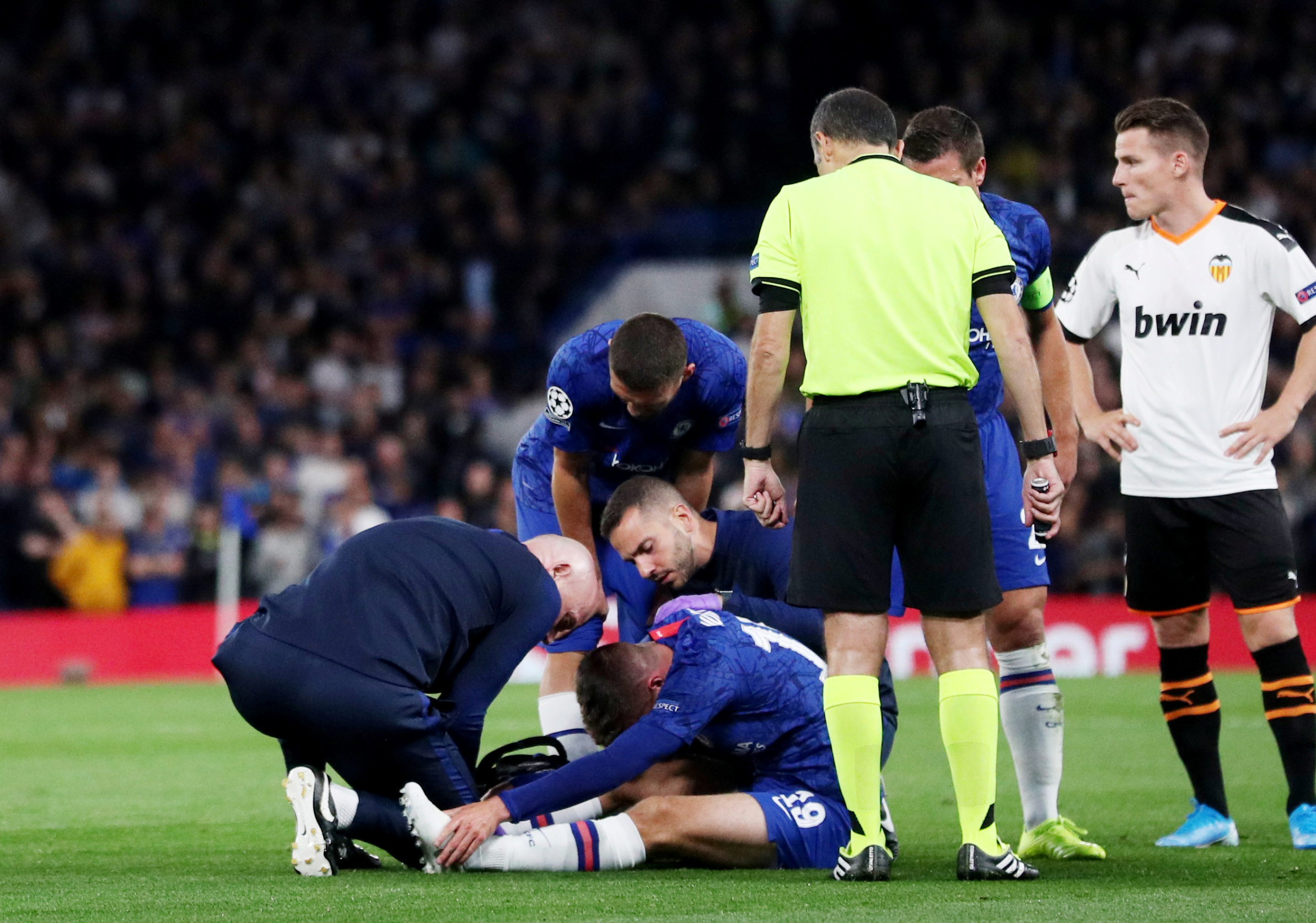 Soccer Football - Champions League - Group H - Chelsea v Valencia - Stamford Bridge, London, Britain - September 17, 2019  Chelsea's Mason Mount receives treatment from physios after being fouled  REUTERS/Hannah McKay
