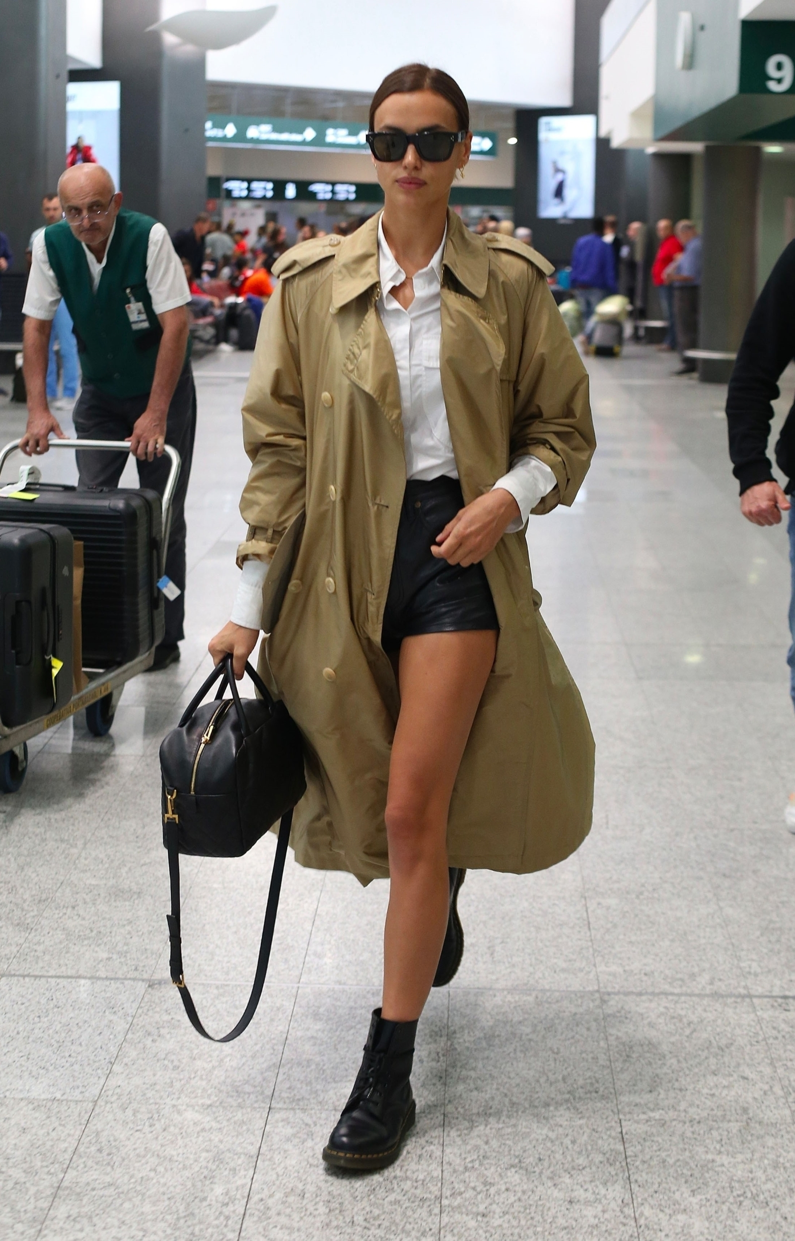 Milan, ITALY  - *EXCLUSIVE*  - The Russian Model Irina Shayk dressed in her long beige mac with dark shades arriving at Milan airport during Milan Fashion Week.  *UK Clients - Pictures Containing Children Please Pixelate Face Prior To Publication*, Image: 471587019, License: Rights-managed, Restrictions: RIGHTS: WORLDWIDE EXCEPT IN ITALY, Model Release: no, Credit line: Profimedia, Backgrid UK