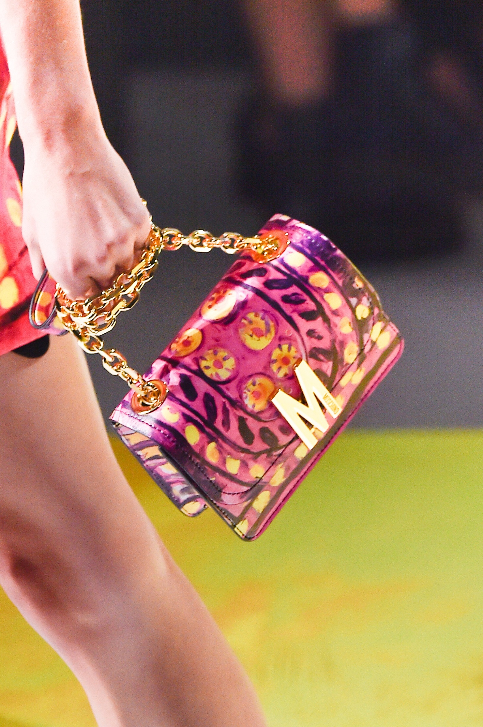 MILAN, ITALY - SEPTEMBER 19: A model, bag detail, walks the runway at the Moschino show during the Milan Fashion Week Spring/Summer 2020 on September 19, 2019 in Milan, Italy. (Photo by Pietro D'Aprano/Getty Images)