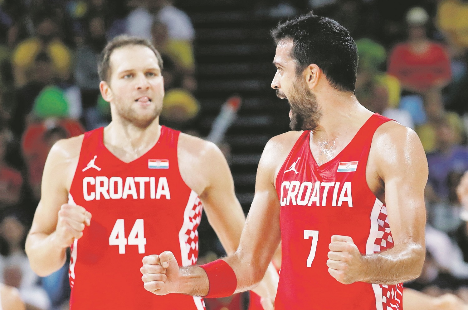 2016 Rio Olympics - Basketball - Preliminary - Men's Preliminary Round Group B Brazil v Croatia - Carioca Arena 1 - Rio de Janeiro, Brazil - 11/08/2016. Krunoslav Simon (CRO) of Croatia and Bojan Bogdanovic (CRO) of Croatia celebrate. REUTERS/Jim Young FOR EDITORIAL USE ONLY. NOT FOR SALE FOR MARKETING OR ADVERTISING CAMPAIGNS.