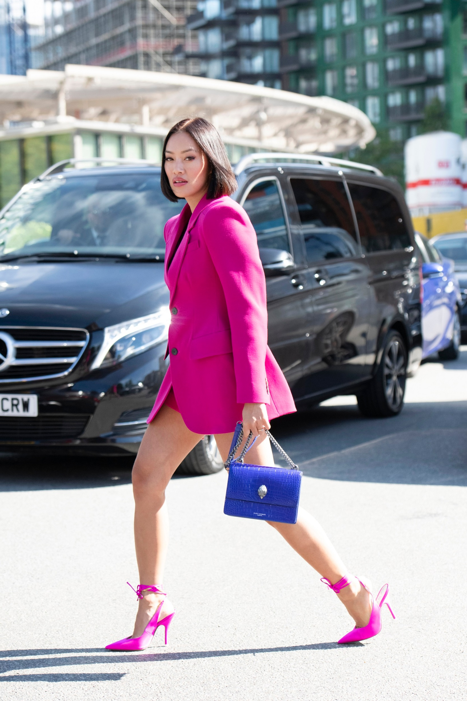 LONDON, ENGLAND - SEPTEMBER 15: Tiffany Hsu wears The Attico shoes and skirt, Balenciaga jacket and a Kurt Geiger bag on September 15, 2019 in London, England. (Photo by Kirstin Sinclair/Getty Images for Kurt Geiger)