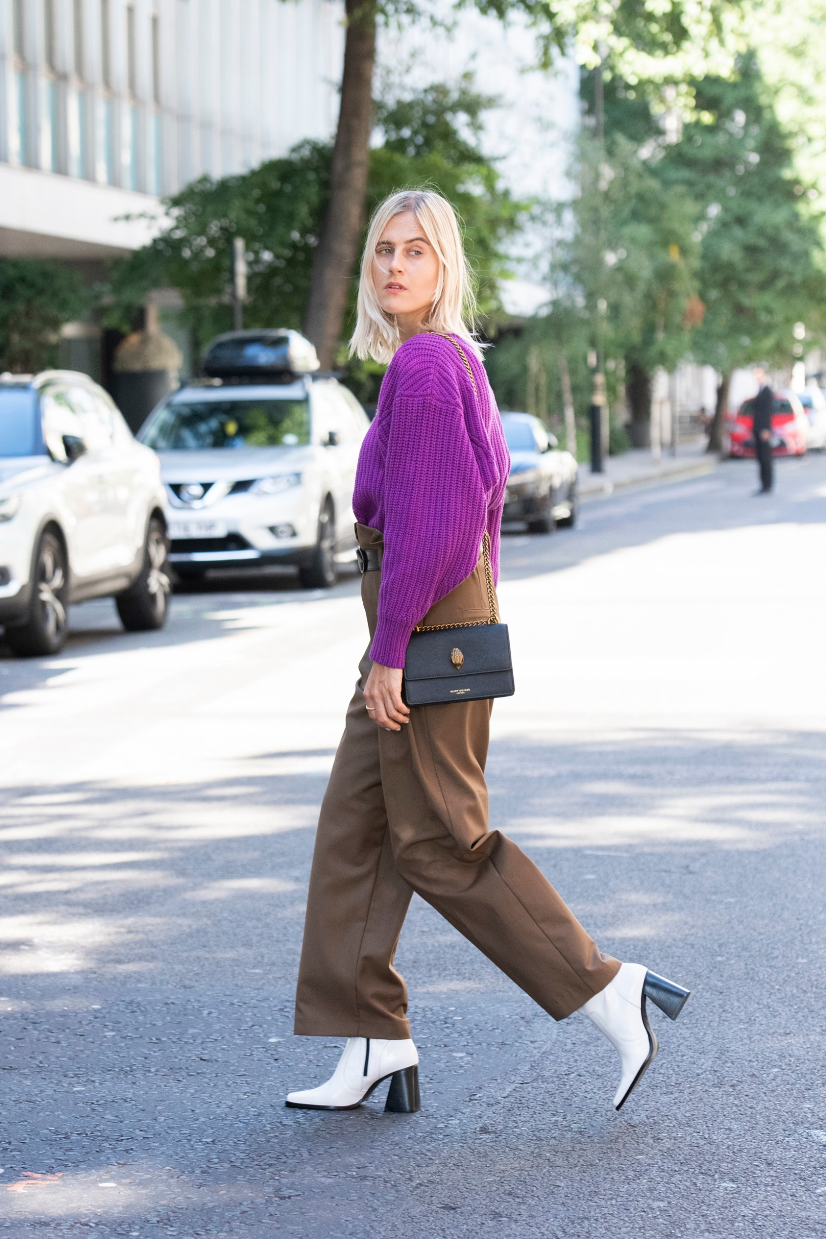 LONDON, ENGLAND - SEPTEMBER 15: Linda Tol wears Frankie shop trousers and belt, Loulou Studio sweater, Kurt Geiger boots and bag on September 15, 2019 in London, England. (Photo by Kirstin Sinclair/Getty Images for Kurt Geiger)