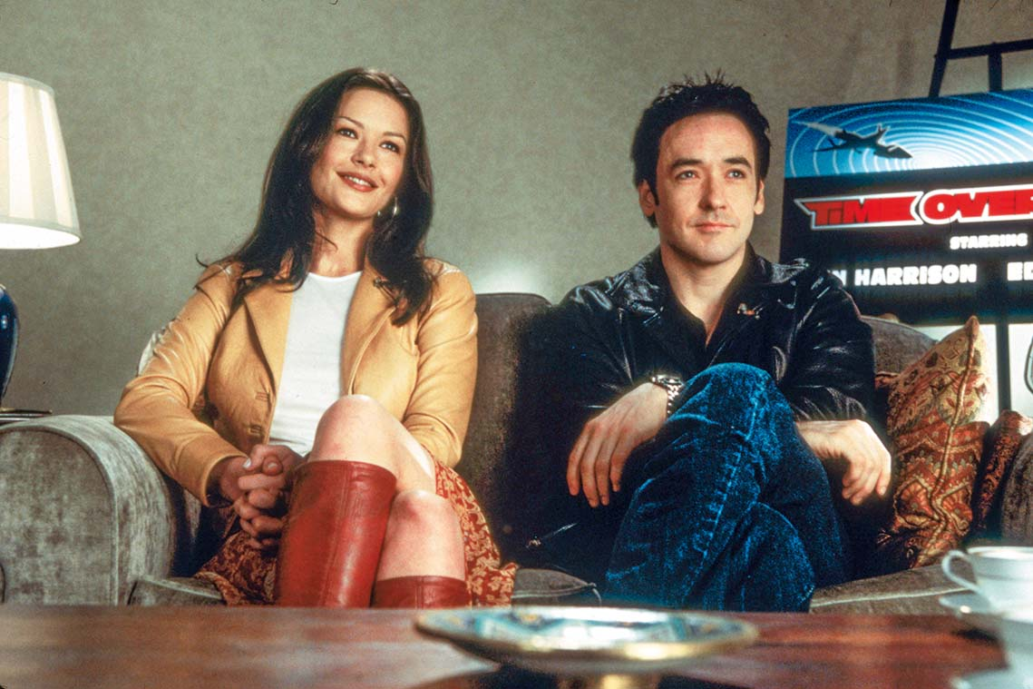 392452 01: Actress Catherine Zeta-Jones and Actor John Cusack perform in the film