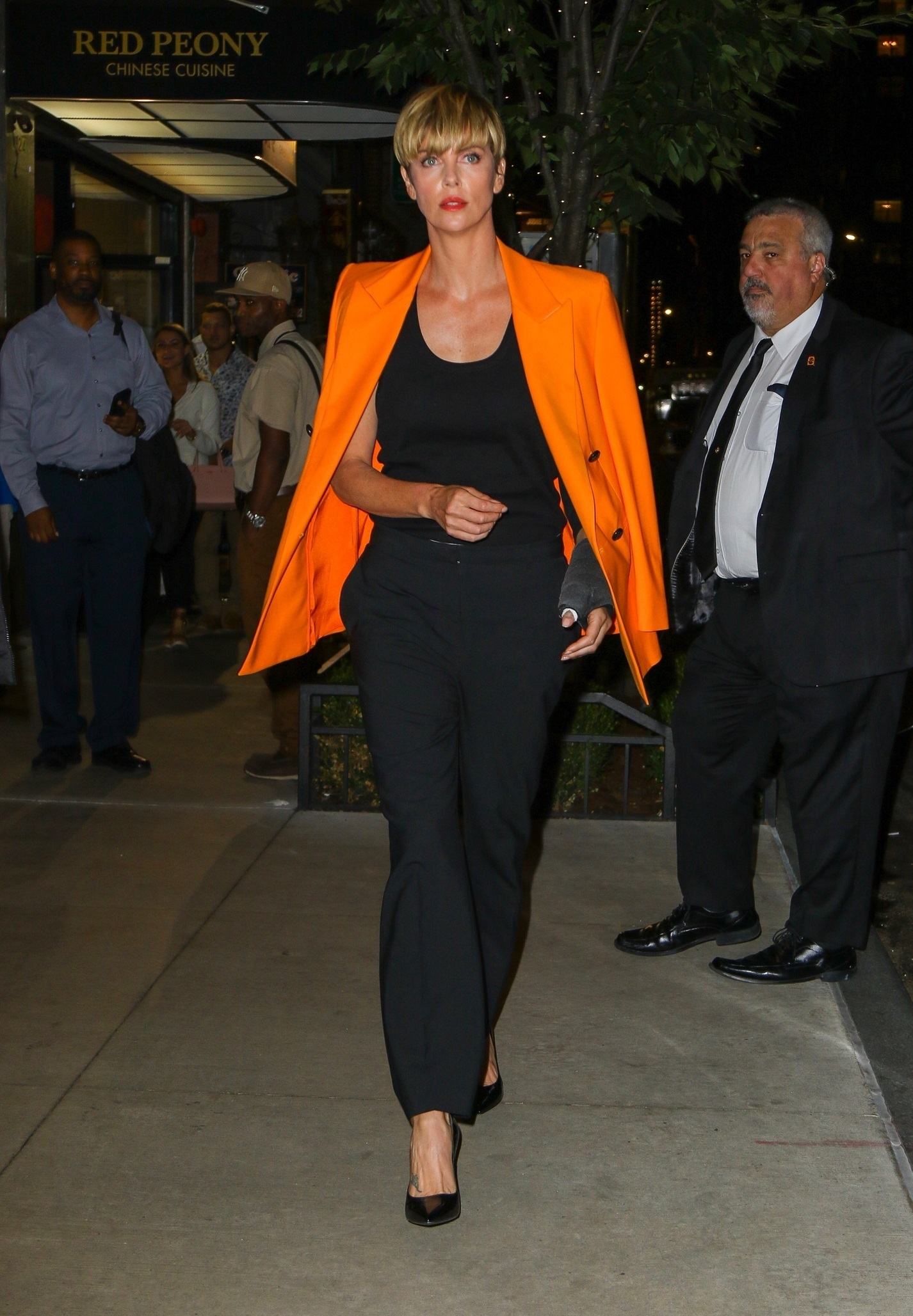 New York, NY  - Charlize Theron looks stylish in an all-black ensemble and orange blazer while out and about in New York.  BACKGRID USA 24 SEPTEMBER 2019, Image: 472984227, License: Rights-managed, Restrictions: , Model Release: no, Credit line: Profimedia, Backgrid USA, Fernando Ramales / BACKGRID