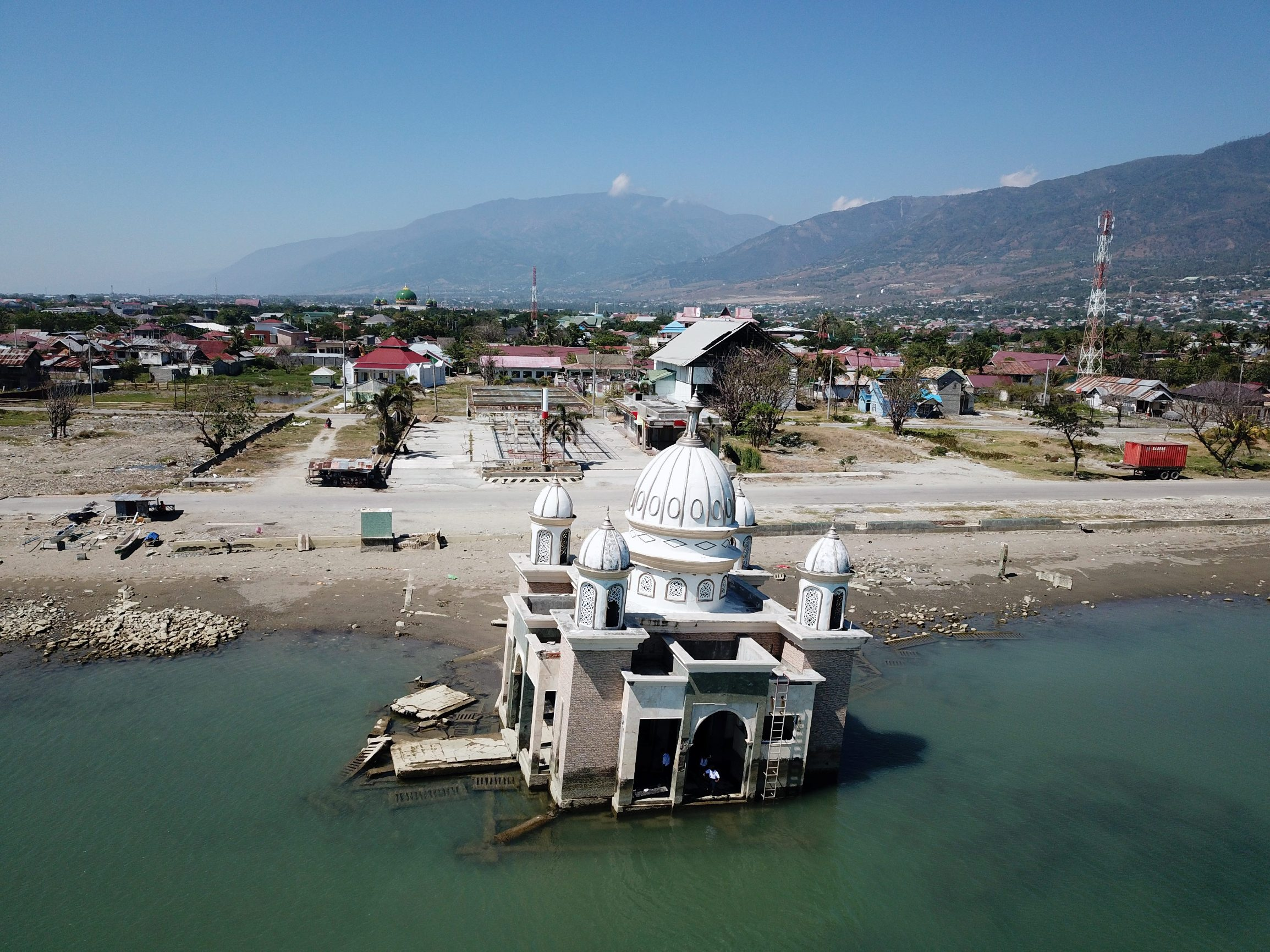 An aerial view of a devastated region nearly one year after an earthquake and tsunami, taken over Sulawesi, Indonesia, sometime in September 2019 by a drone and obtained from social media. UN OCHA Asia-Pacific via REUTERS   THIS IMAGE HAS BEEN SUPPLIED BY A THIRD PARTY. MANDATORY CREDIT. NO RESALES. NO ARCHIVES.