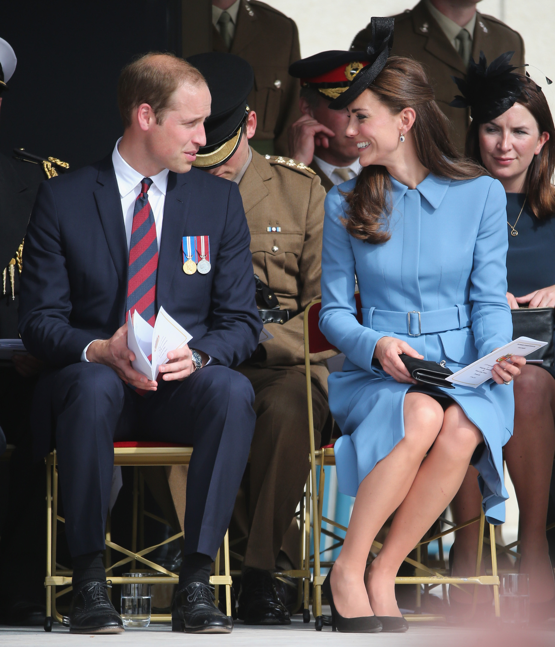ARROMANCHES LES BAINS, FRANCE - JUNE 06:  Prince William, Duke of Cambridge and Catherine, Duchess of Cambridge chat as they attend the 70th anniversary of the D-Day landings on June 6, 2014 in Arromanches Les Bains, France.  Friday 6th June is the 70th anniversary of the D-Day landings which saw 156,000 troops from the allied countries including the United Kingdom and the United States join forces to launch an audacious attack on the beaches of Normandy, these assaults are credited with the eventual defeat of Nazi Germany. A series of events commemorating the 70th anniversary are planned for the week with many heads of state travelling to the famous beaches to pay their respects to those who lost their lives.  (Photo by Christopher Furlong/Getty Images)