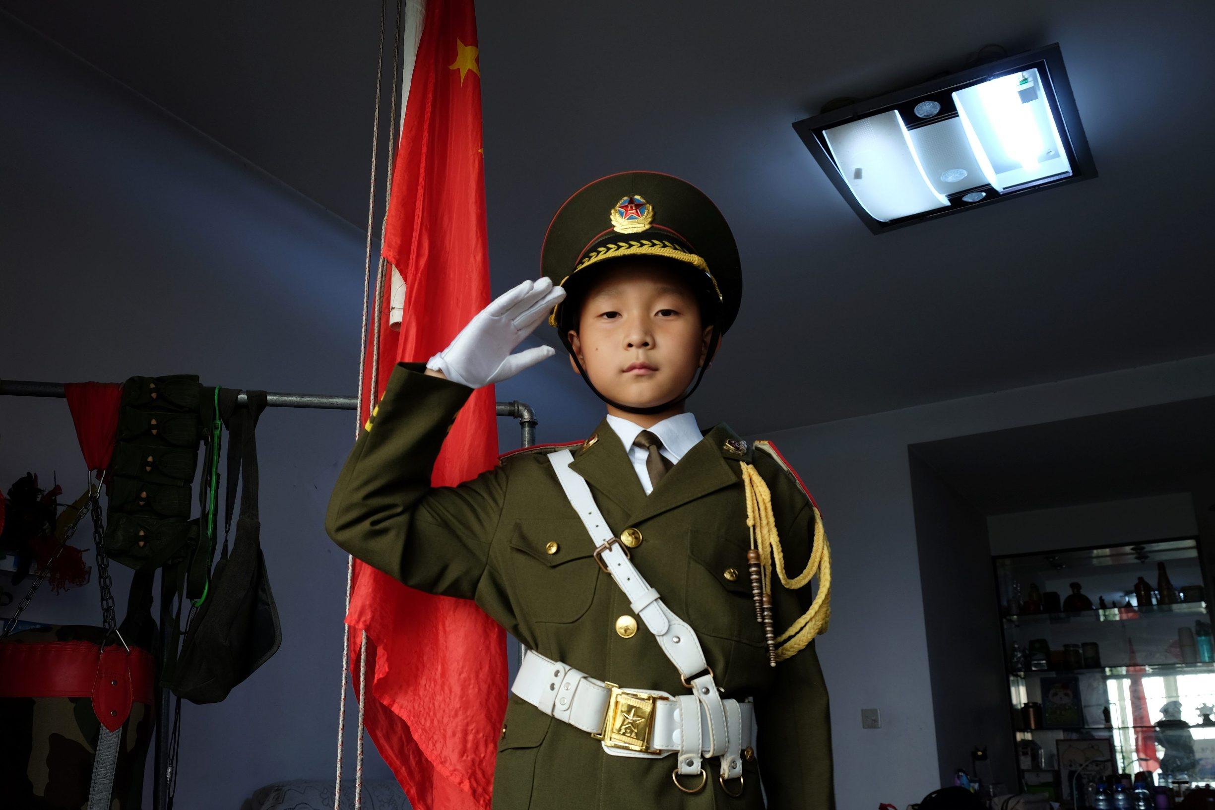 2019-09-28T050648Z_766687284_RC1A732C1330_RTRMADP_3_CHINA-ANNIVERSARY-FLAG-BOY