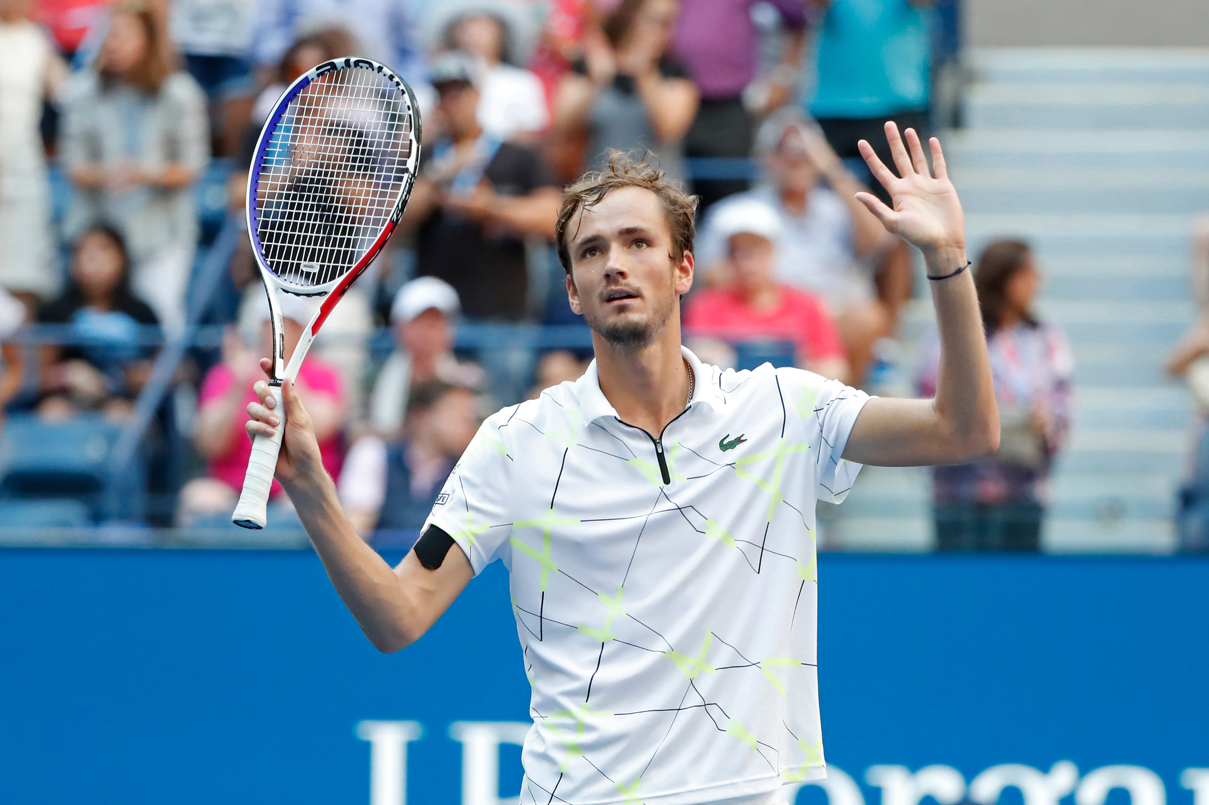 Sep 3, 2019; Flushing, NY, USA; Daniil Medvedev of Russia waves to the crowd after his match against Stan Wawrinka of Switzerland (not pictured) in a quarterfinal match on day nine of the 2019 US Open tennis tournament at USTA Billie Jean King National Tennis Center. Mandatory Credit: Geoff Burke-USA TODAY Sports - 13302804