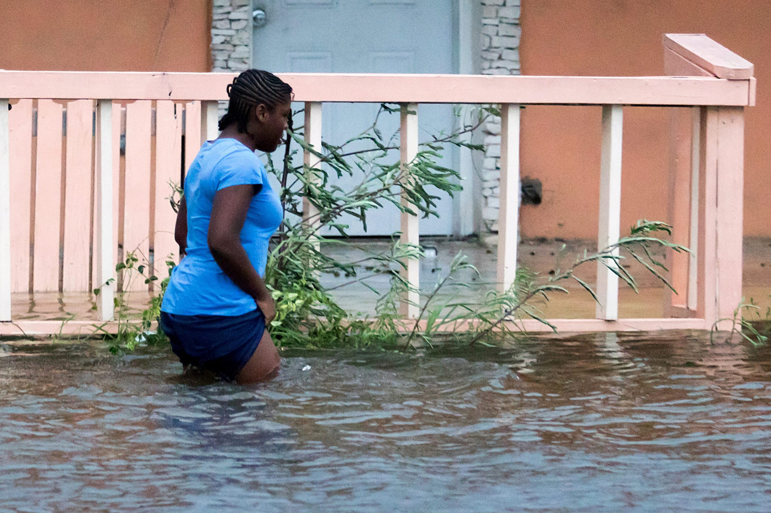 A woman walks in a flooded street after the effects of Hurricane Dorian arrived in Nassau, Bahamas, September 2, 2019. REUTERS/John Marc Nutt MANDATORY CREDIT. NO RESALES. NO ARCHIVES