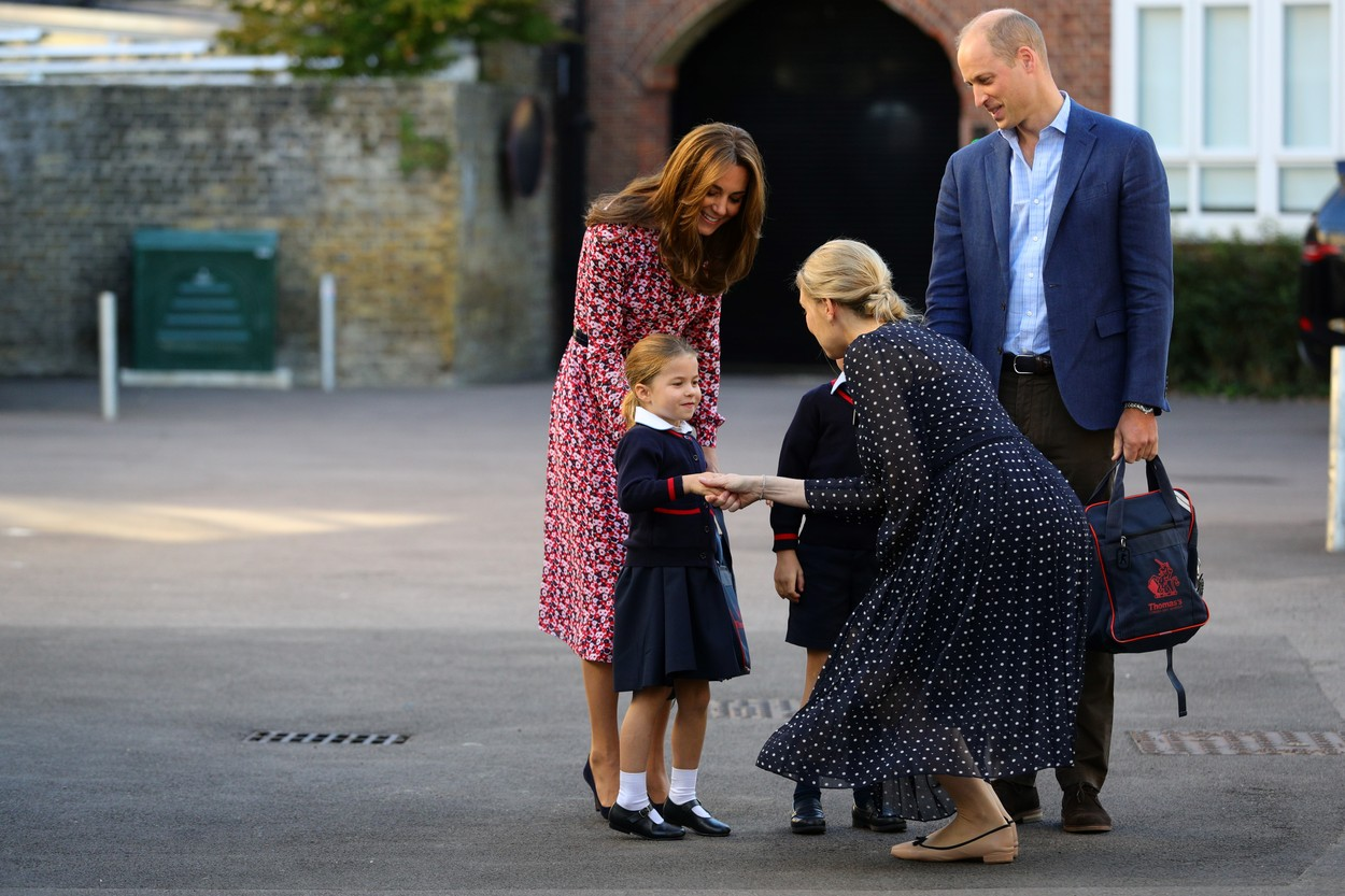 Britain's Princess Charlotte of Cambridge, accompanied by her father, Britain's Prince William, Duke of Cambridge, her mother, Britain's Catherine, Duchess of Cambridge, is greeted by Helen Haslem, head of the lower school (CR) on her arrival for her first day of school at Thomas's Battersea in London on September 5, 2019., Image: 469234775, License: Rights-managed, Restrictions: , Model Release: no, Credit line: Profimedia, AFP