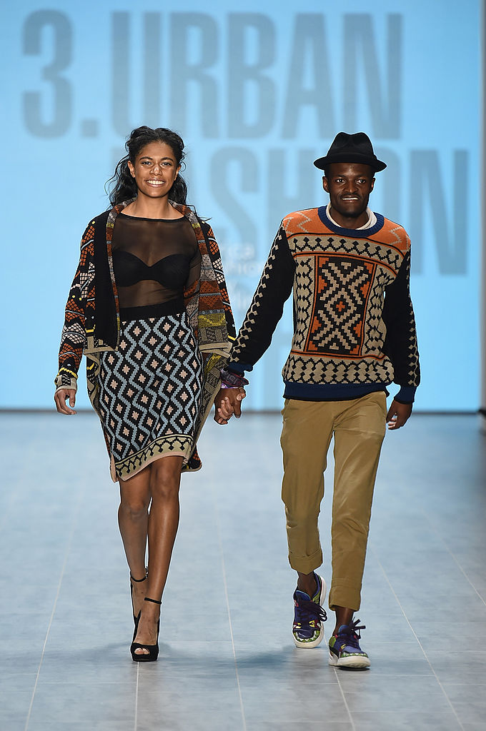 BERLIN, GERMANY - JULY 08:  Designer (R) Laduma Ngxokolo and a model walk the runway at the 1981, Maxhosa By Laduma, Soboye show during the Mercedes-Benz Fashion Week Spring/Summer 2015 at Erika Hess Eisstadion on July 8, 2014 in Berlin, Germany.  (Photo by Frazer Harrison/Getty Images for Mercedes-Benz)