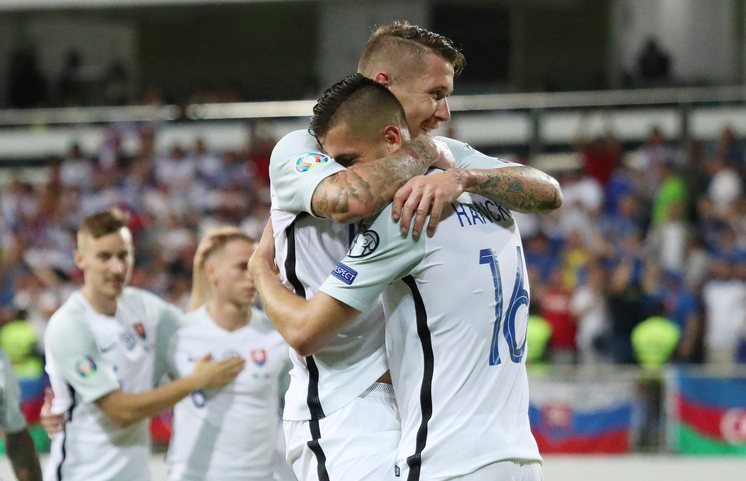 Soccer Football - Euro 2020 Qualifier - Group E - Azerbaijan v Slovakia - Bakcell Arena, Baku, Azerbaijan - June 11, 2019  Slovakia's David Hancko celebrates scoring their fifth goal with team mates   REUTERS/Aziz Karimov