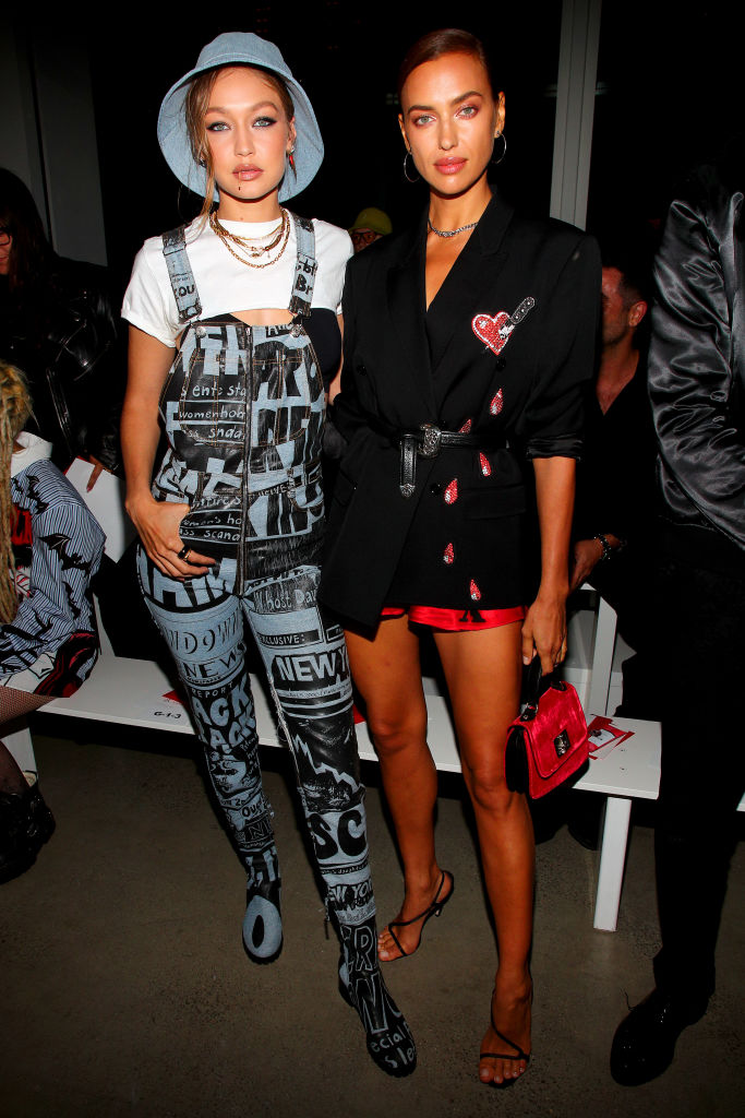 NEW YORK, NEW YORK - SEPTEMBER 06: Gigi Hadid (L) and Irina Shayk attend the Jeremy Scott front row during New York Fashion Week: The Shows at Gallery I at Spring Studios on September 06, 2019 in New York City. (Photo by Astrid Stawiarz/Getty Images for NYFW: The Shows)