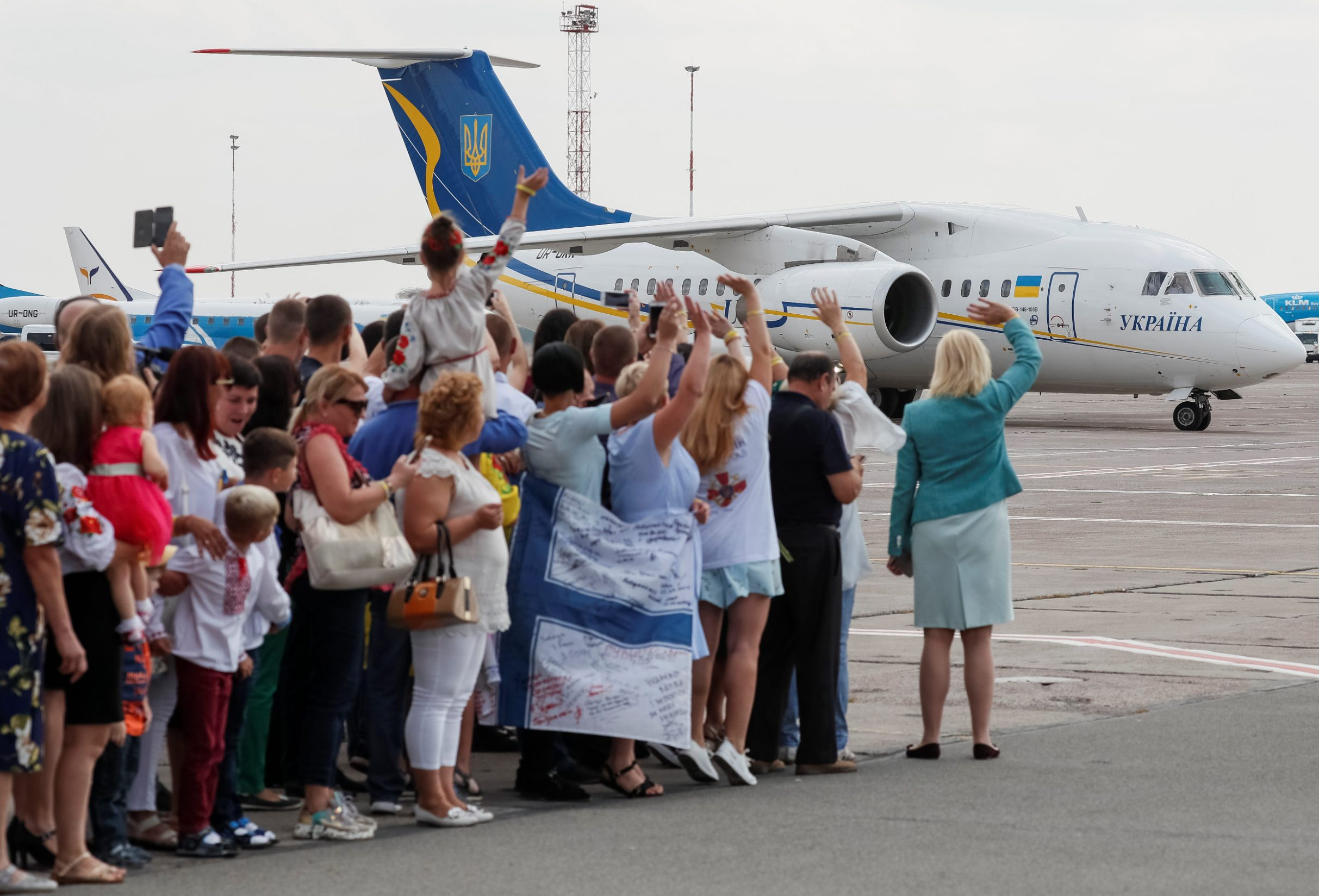 A plane carrying Ukrainian prisoners, included in the Russia-Ukraine prisoner swap, is seen on the tarmac, as prisoners' relatives greet them at Borispil International Airport, outside Kiev, Ukraine September 7, 2019. REUTERS/Gleb Garanich