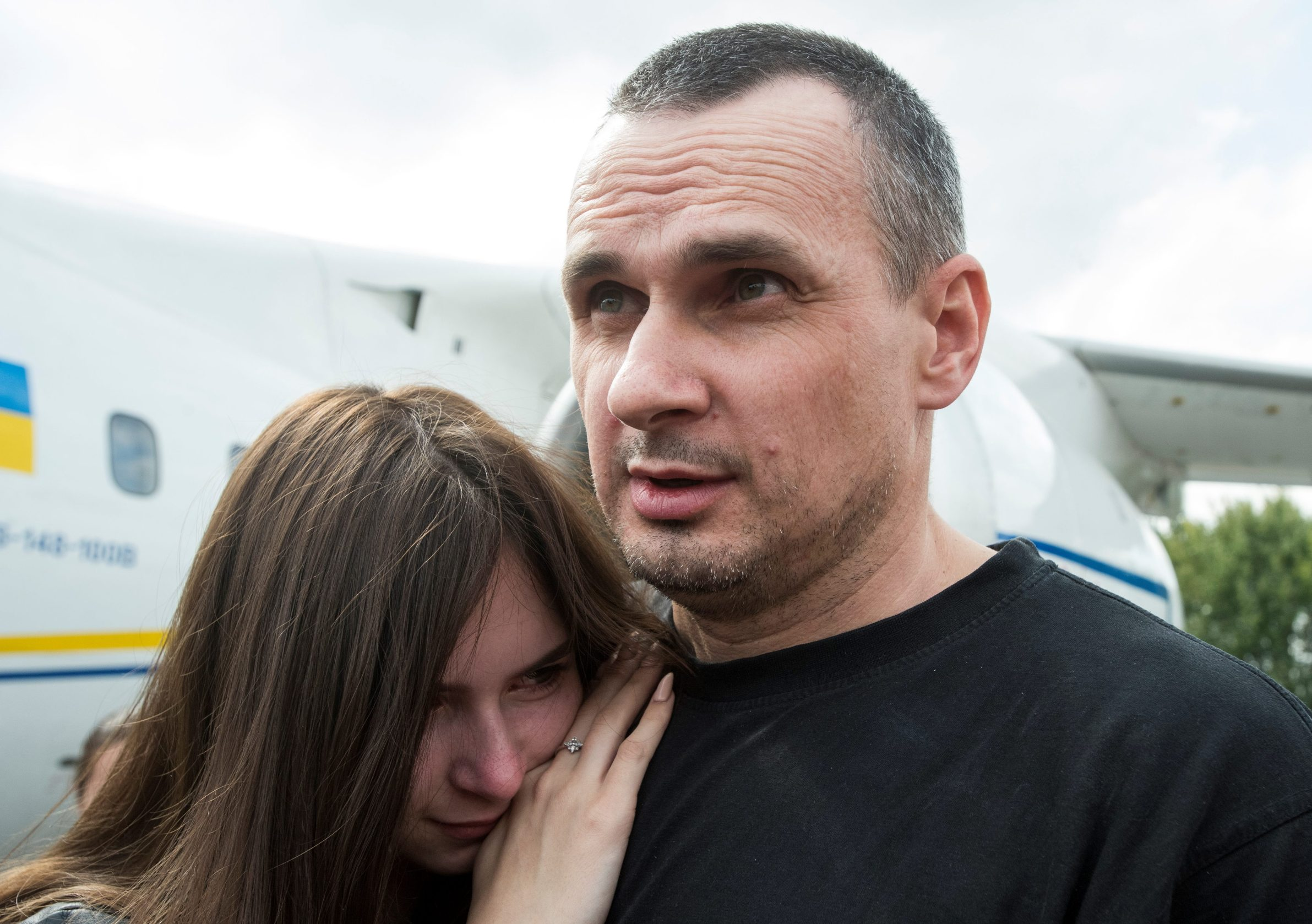 Ukrainian film director Oleg Sentsov hugs his daughter Alina Sentsova upon arrival in Kiev after Russia-Ukraine prisoner swap, at Borispil International Airport, outside Kiev, Ukraine September 7, 2019. REUTERS/Oleksandr Klymenko