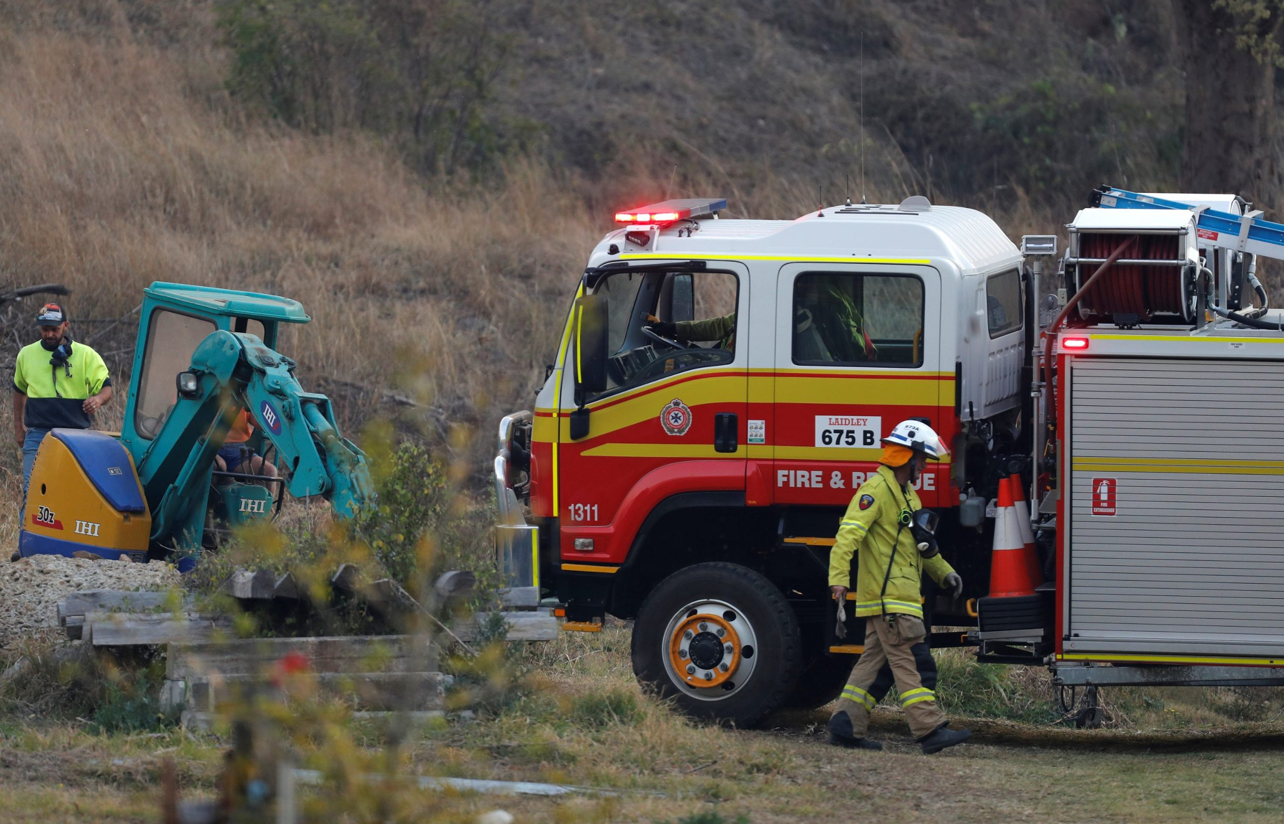 Fire and Emergency crew prepare to battle bushfire near a house in the rural town of Canungra in the Scenic Rim region of South East Queensland, Australia, September 6, 2019. Picture taken September 6, 2019.  Regi Varghese/AAP/via REUTERS    ATTENTION EDITORS - THIS IMAGE WAS PROVIDED BY A THIRD PARTY. NO RESALES. NO ARCHIVE. AUSTRALIA OUT. NEW ZEALAND OUT. NO COMMERCIAL OR EDITORIAL SALES IN NEW ZEALAND. NO COMMERCIAL OR EDITORIAL SALES IN AUSTRALIA.