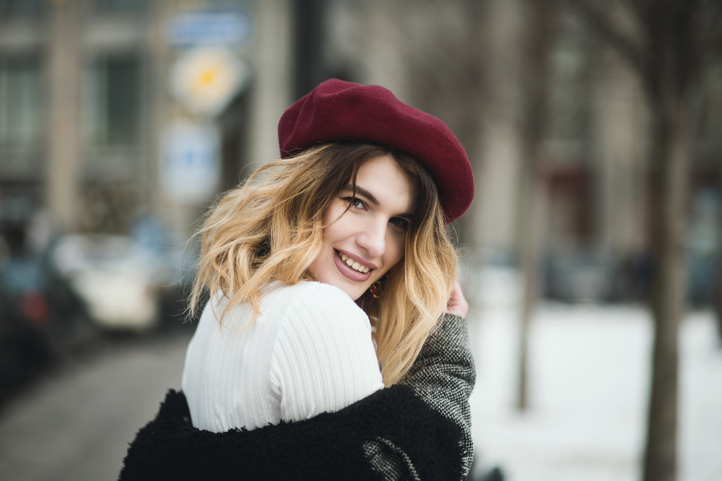selective-focus-photography-of-smiling-woman-wearing-red-hat-1381558