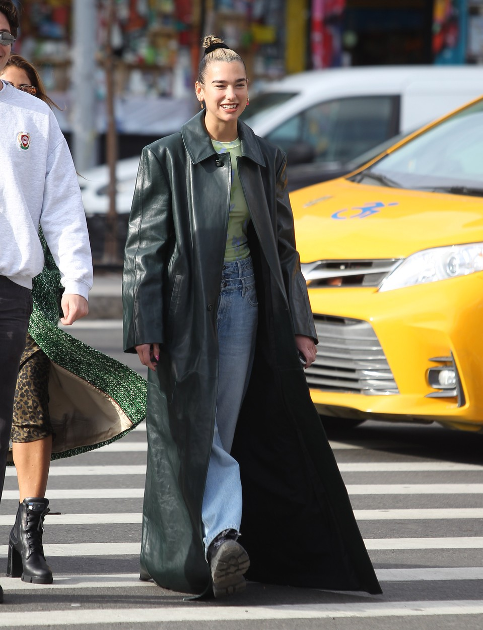 01/11/2020 Dua Lipa channels The Matrix with a long black leather trench coat in New York City. The 24 year old English singer, songwriter strolled the street with an entourage wearing high waisted denim jeans paired with a lime green top and black combat boots., Image: 492200154, License: Rights-managed, Restrictions: NO usage without agreed price and terms. Please contact sales@theimagedirect.com, Model Release: no, Credit line: TheImageDirect.com / The Image Direct / Profimedia